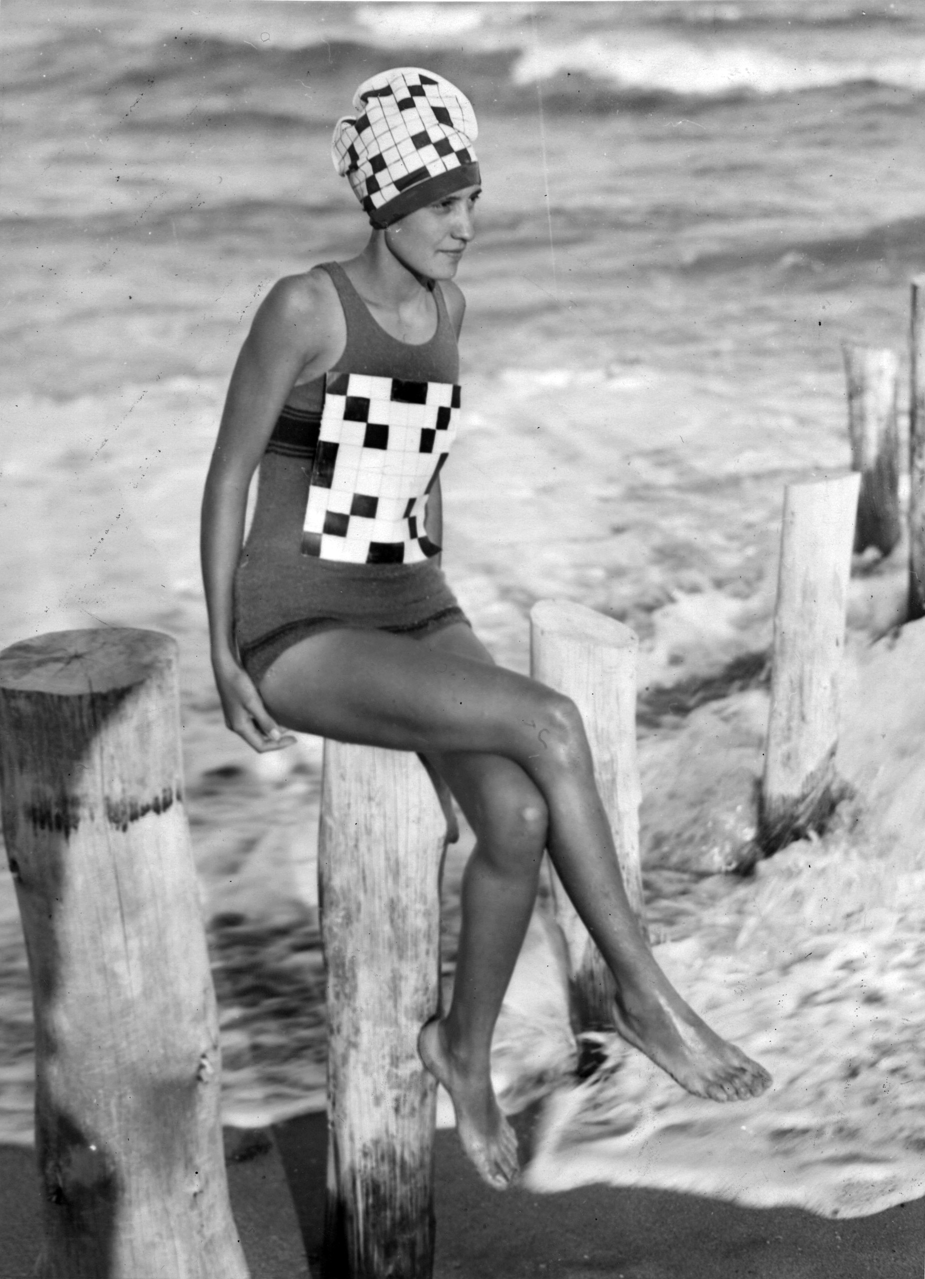 Verna Lee Fisher sporting her newly created crossword swimsuit with matching bathing hat, at Palm Beach, Fla., circa 1933.
