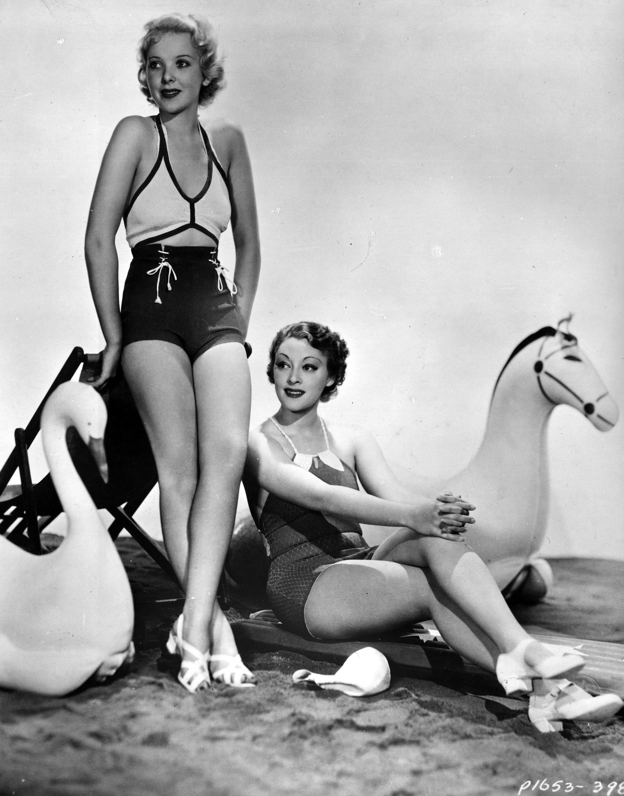 Actresses Ida Lupino and Kathleen Burke model the latest swimwear circa 1935