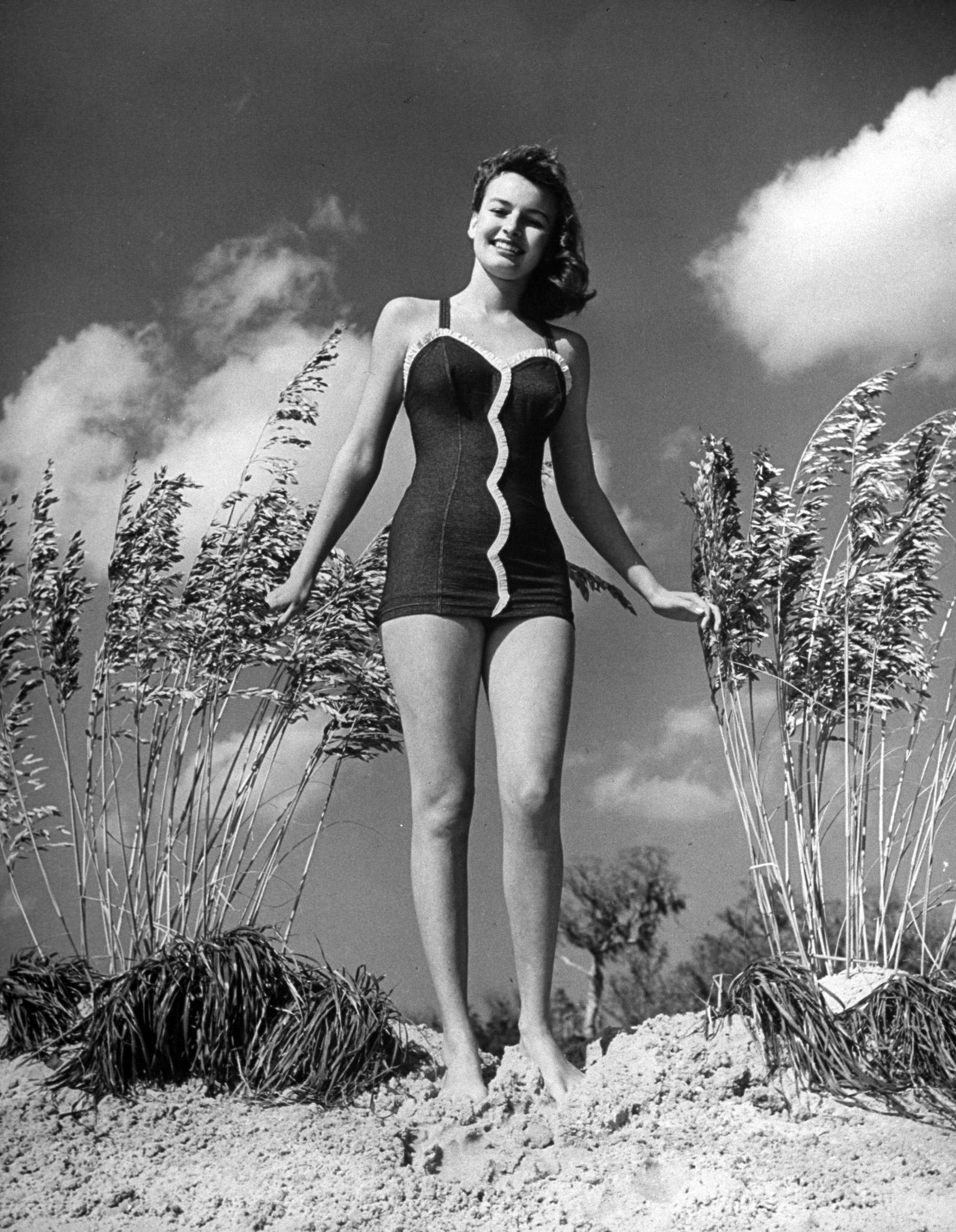 Model posing in bathing suit in Florida, circa 1945.