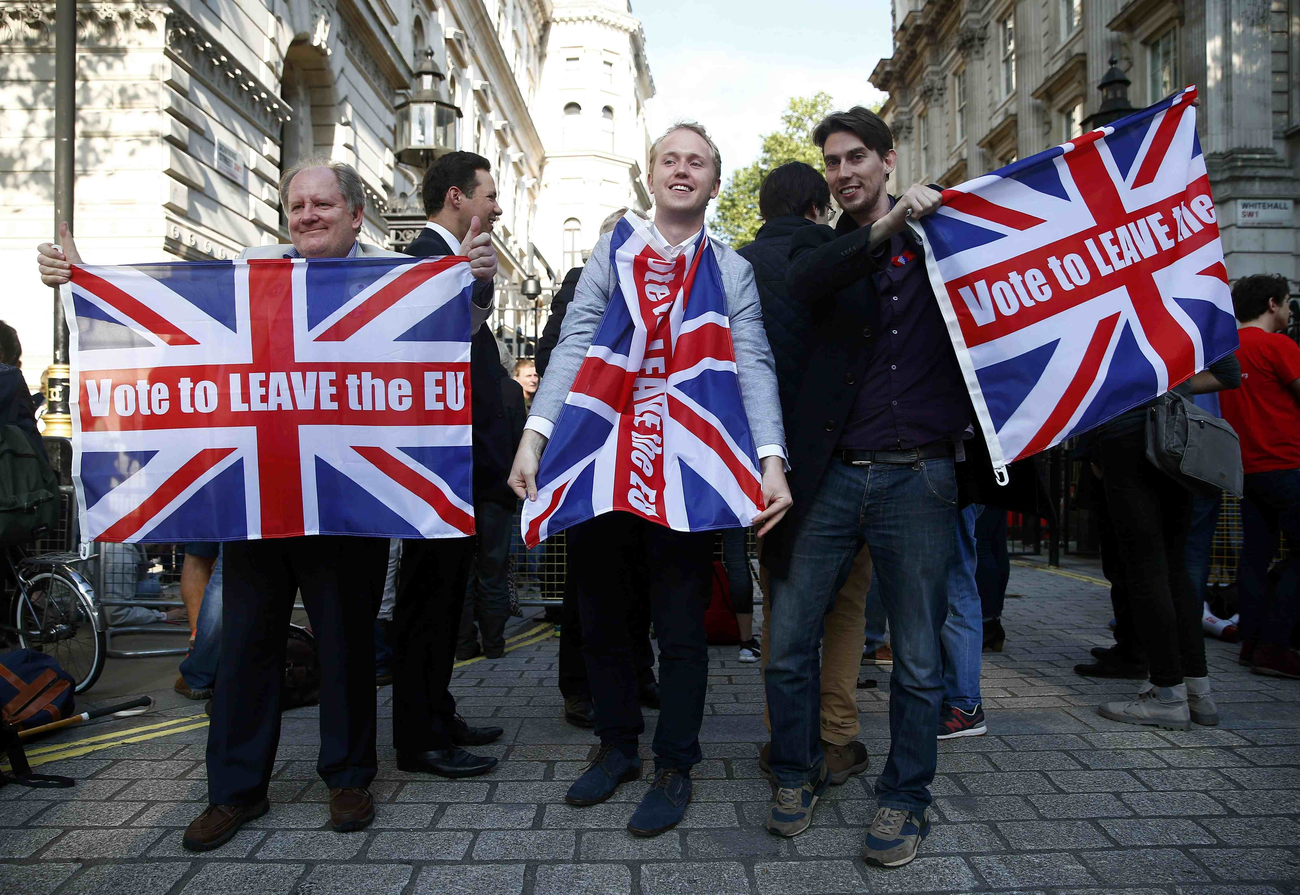Vote leave supporters wave Union flags, following the result of the EU referendum, outside Downing Street in London on June 24, 2016.