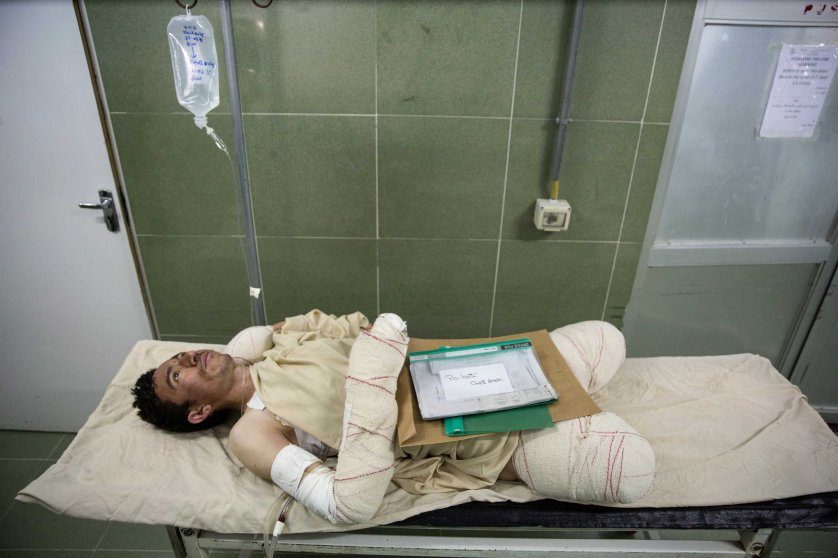 Sayed Malik, 25, waits to go into surgery. He lost his legs while demining, as a ANA soldier in Sangin. Lashkar Gah, Afghanistan on March 26, 2015.