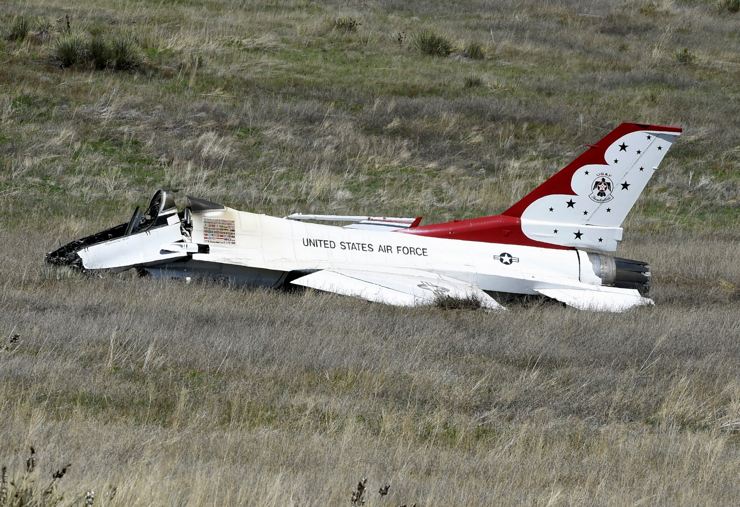 A U.S. Air Force Thunderbird that crashed following a flyover a performance at a commencement for Air Force Academy cadets in Colorado Springs, Colo., on June 2, 2016. The pilot ejected safely from the jet.