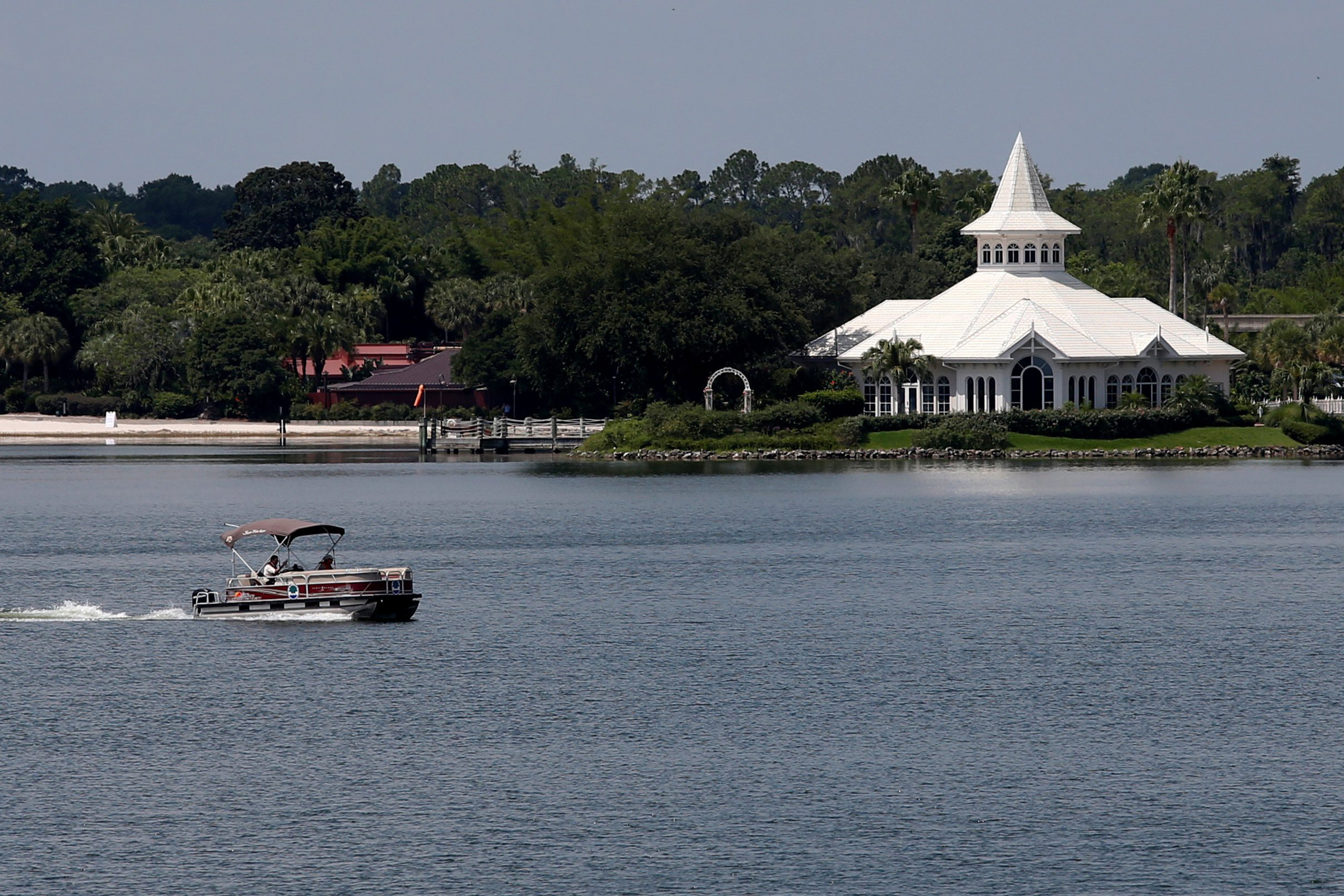 A search boat is seen passing Disney's Fairy Tale Weddings Chapel in the Seven Seas Lagoon, located near the Grand Floridian, at the Walt Disney World resort in Orlando, Fla., on June 15, 2016.