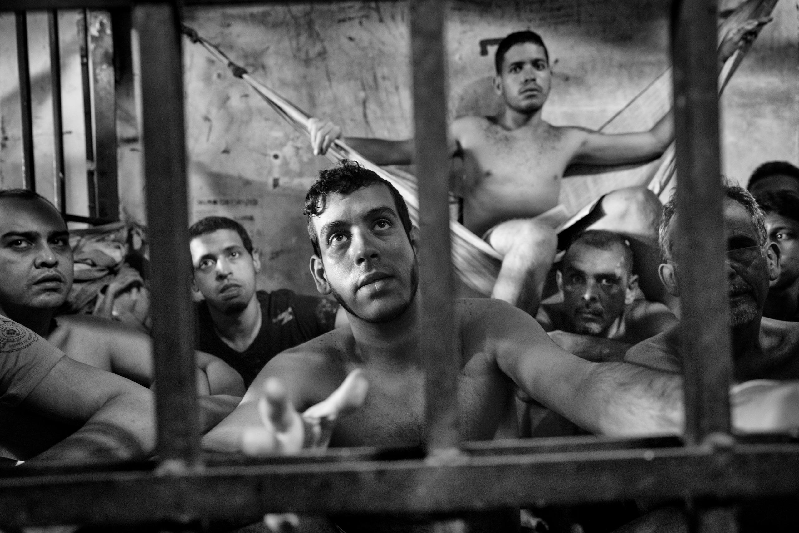 A group of prisoners sit in their cells inside the municipal police station of Chacao, located east of Caracas, Venezuela, May 27, 2016.