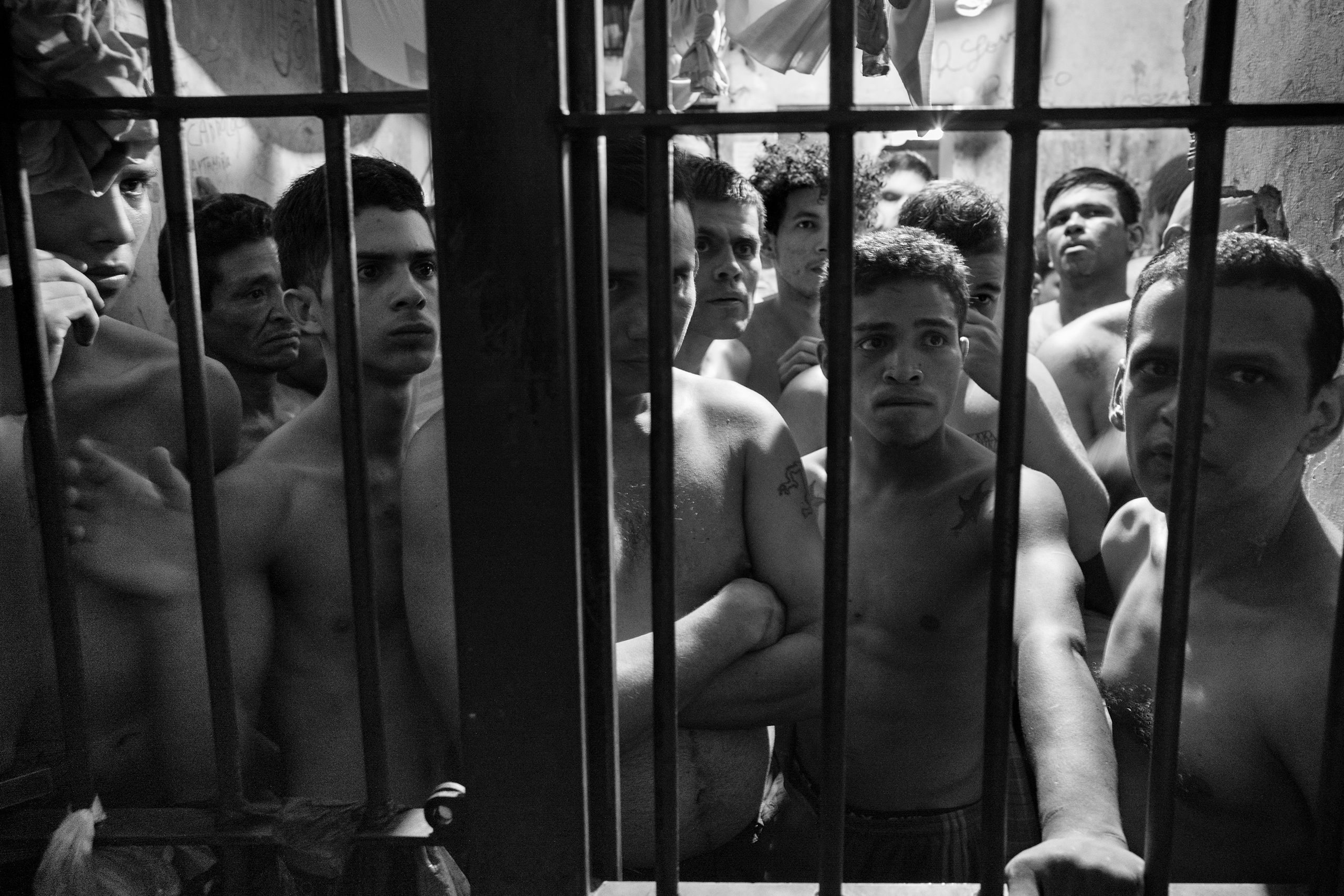 A group of prisoners locked in their cells inside the municipal police station of Chacao, east of Caracas, Venezuela, May 27, 2016.