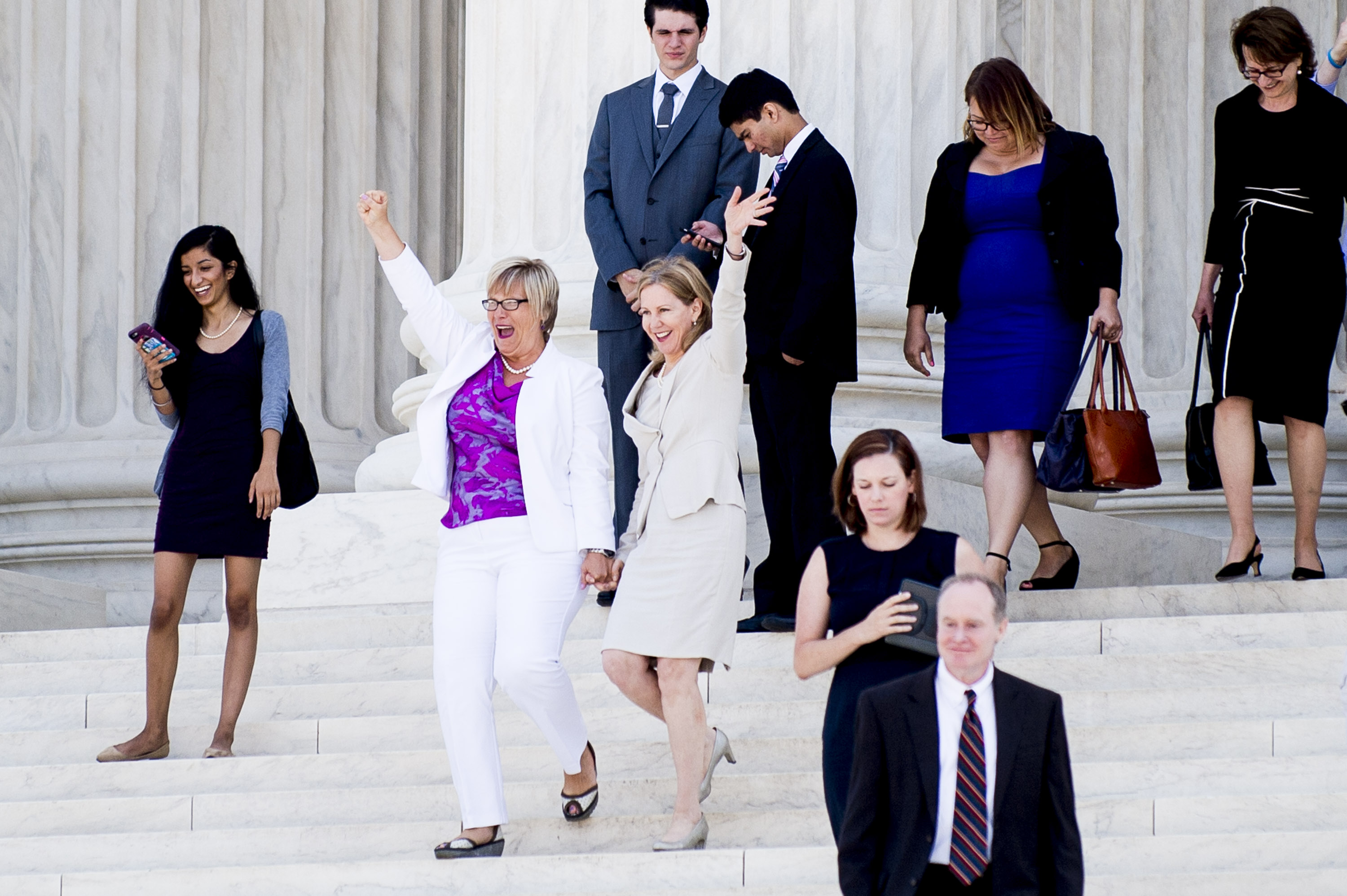 Texas abortion provider Amy Hagstrom-Miller and Nancy Northup, President of The Center for Reproductive Rights wave to supporters as they descend the steps of the United States Supreme Court in Washington, D.C., on June 27, 2016.
