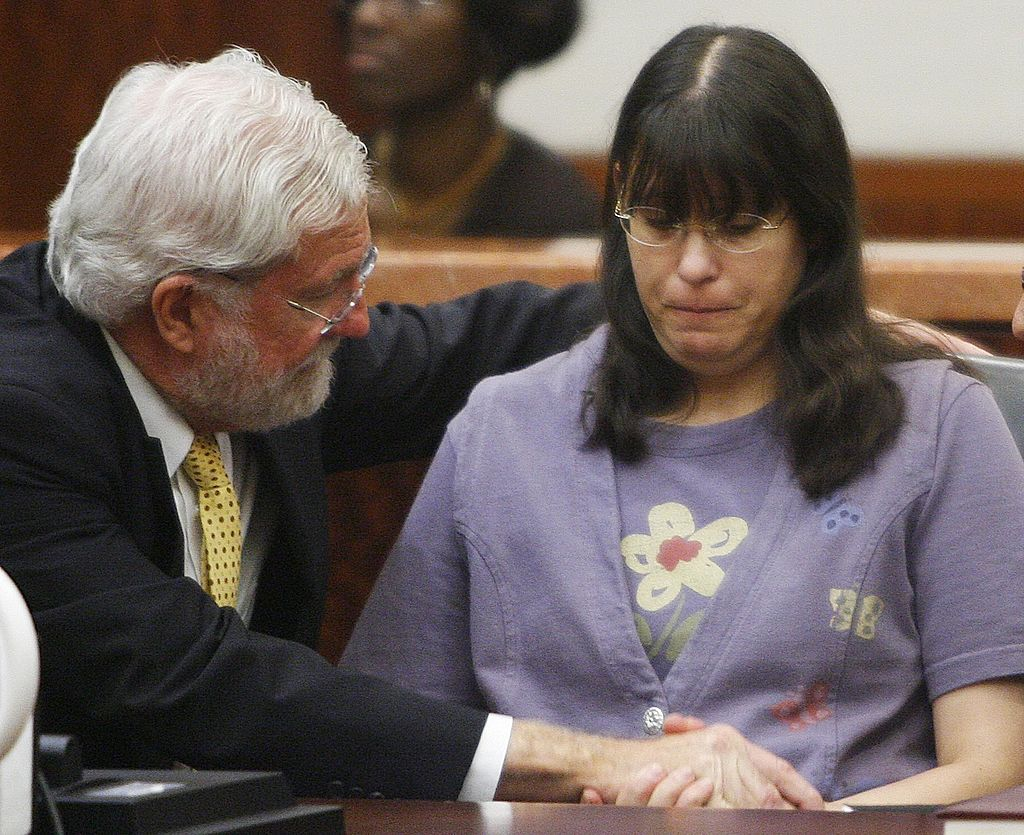 Andrea Yates (R) sits with her attorney George Parnham after the not guilty by reason of insanity verdict was read in her retrial on July 26, 2006 in Houston.
