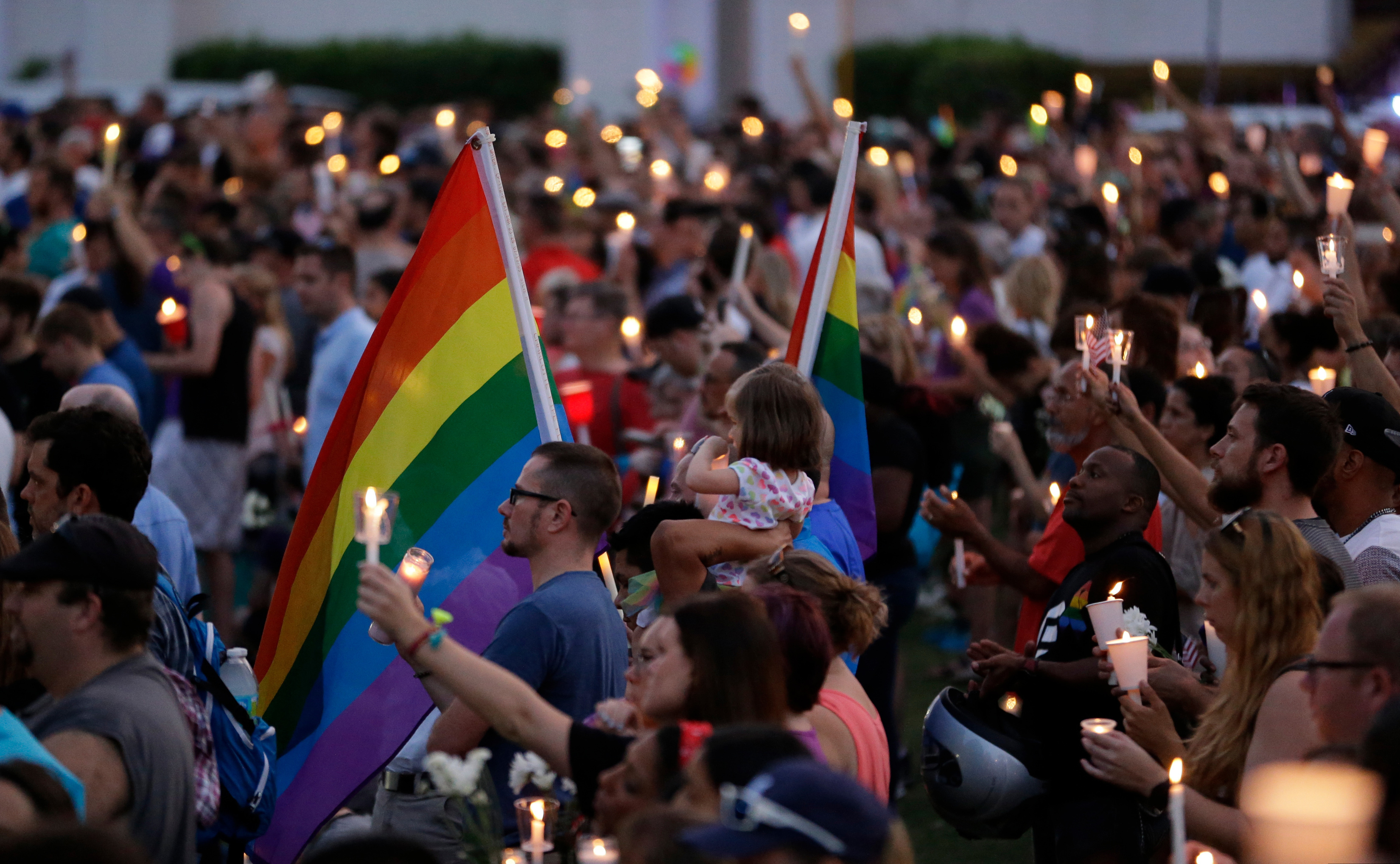 Supporters of the victims of the recent mass shooting at the Pulse nightclub attend a vigil at Lake Eola Park, June 19, 2016, Orlando, Fla.