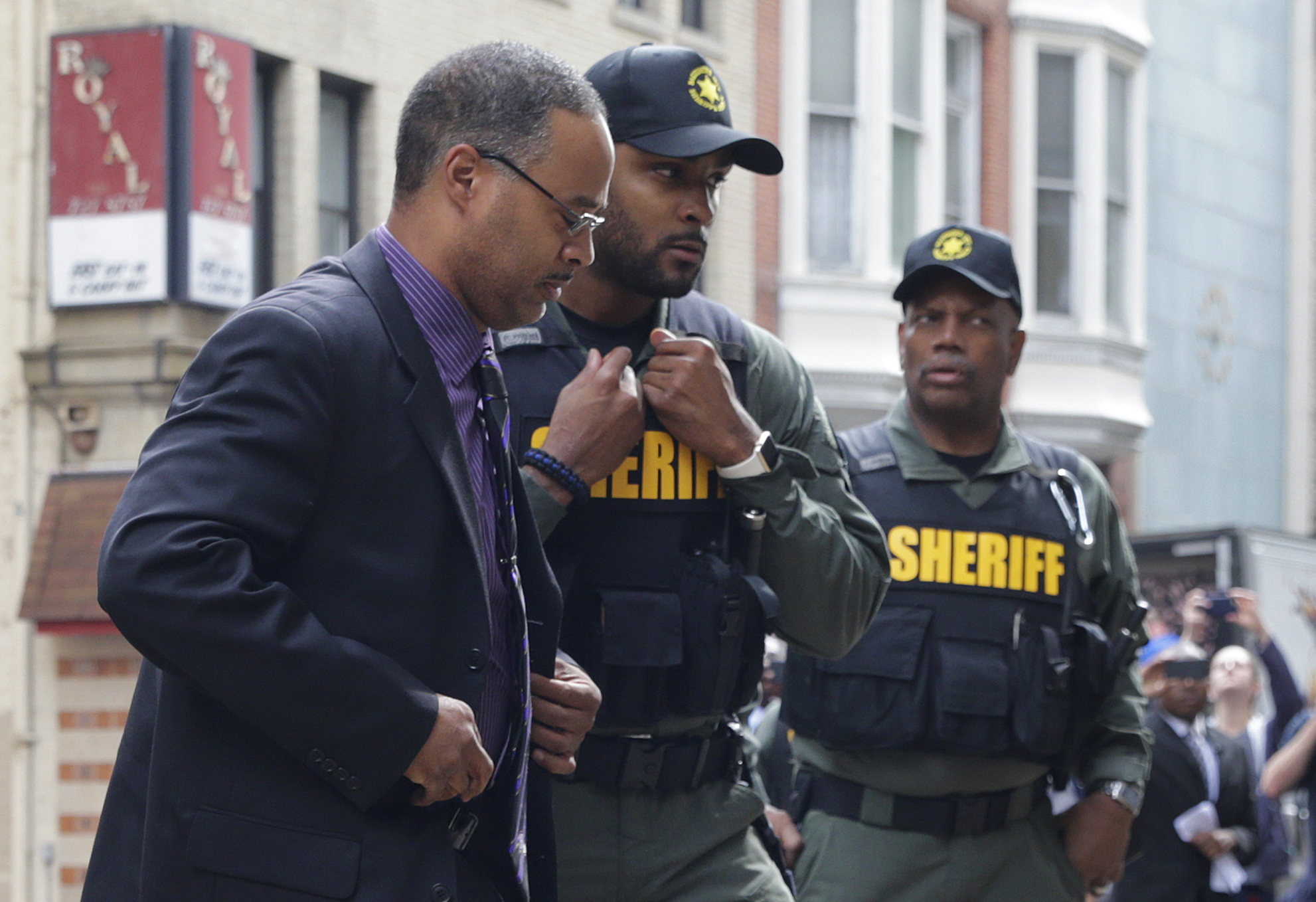 Officer Caesar Goodson, left, one of six Baltimore city police officers charged in connection to the death of Freddie Gray, arrives at a courthouse before receiving a verdict in his trial in Baltimore,  June 23, 2016.