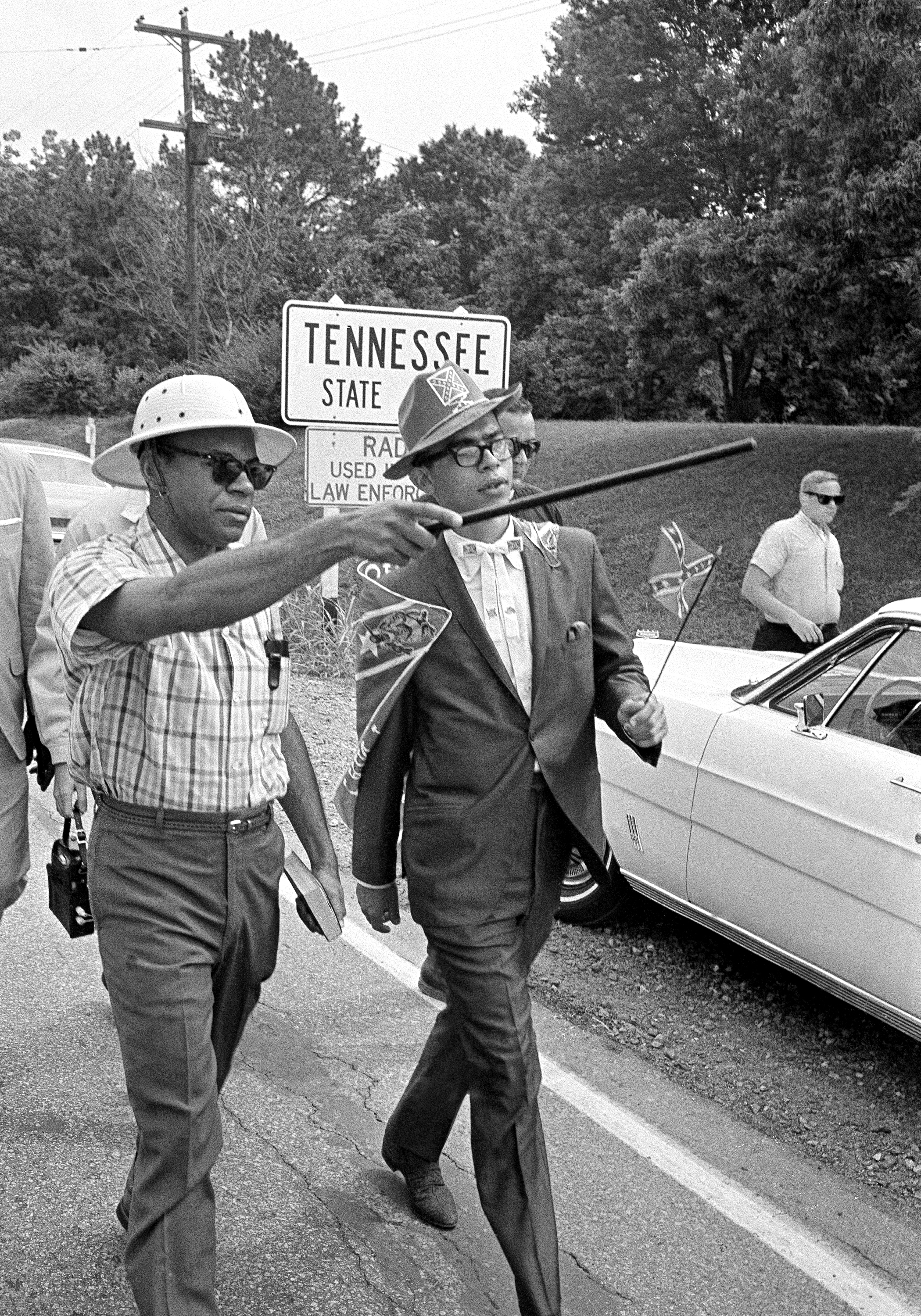 James H. Meredith, with sun helmet, points to the Mississippi state line with a walking cane as Meredith and several others crossed into Mississippi on the second day of a march to Jackson, Miss. on June 6, 1966.