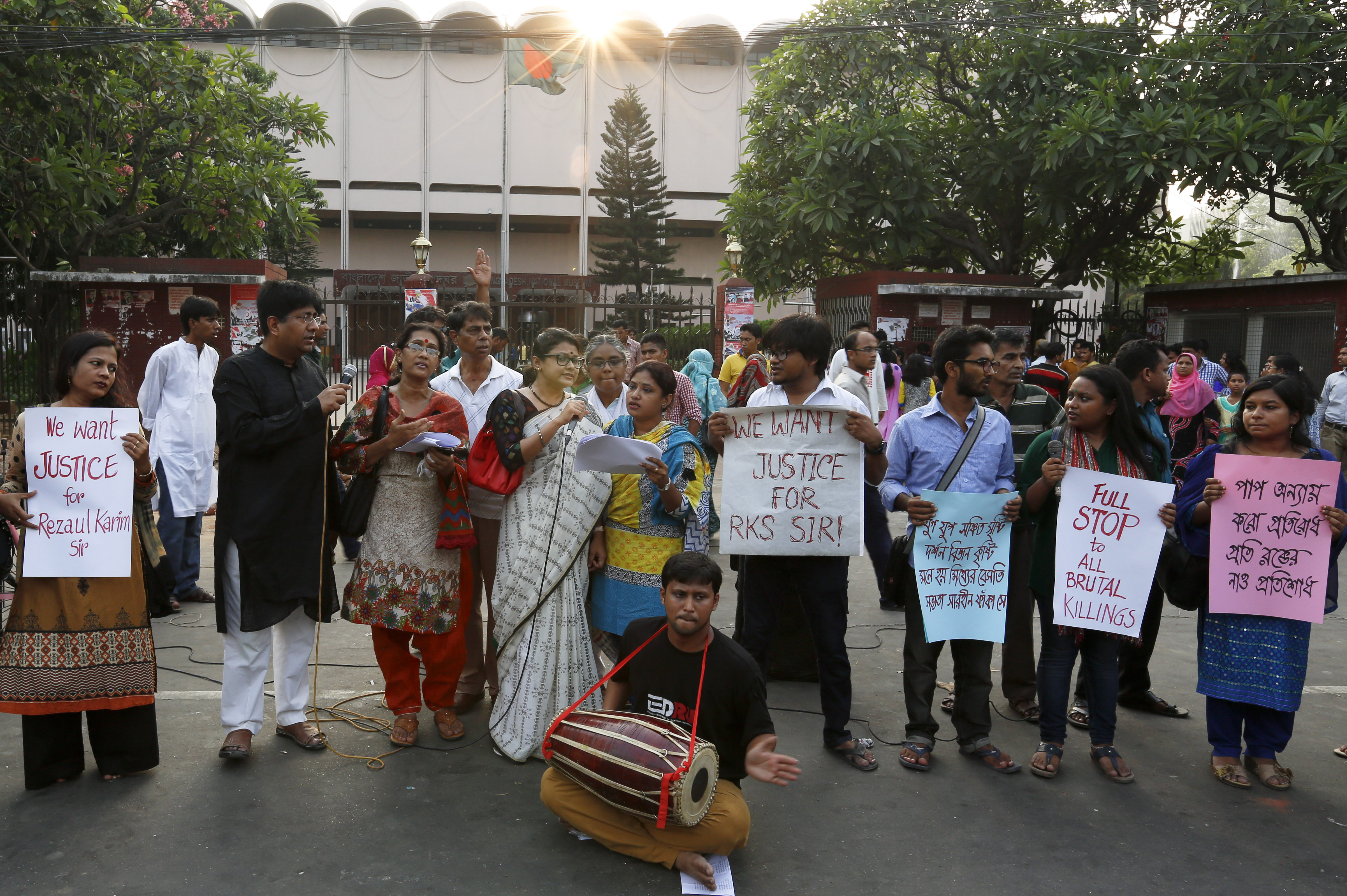Bangladeshi teachers, students and social activists hold banners and sing songs during a protest against the killing of Professor A.F.M. Rezaul Karim Siddique in Dhaka, Bangladesh, on April 29, 2016. Siddique was hacked to death on his way to work at the state-run university in the Bangladeshi city of Rajshahi on April 23, 2016, where he taught English