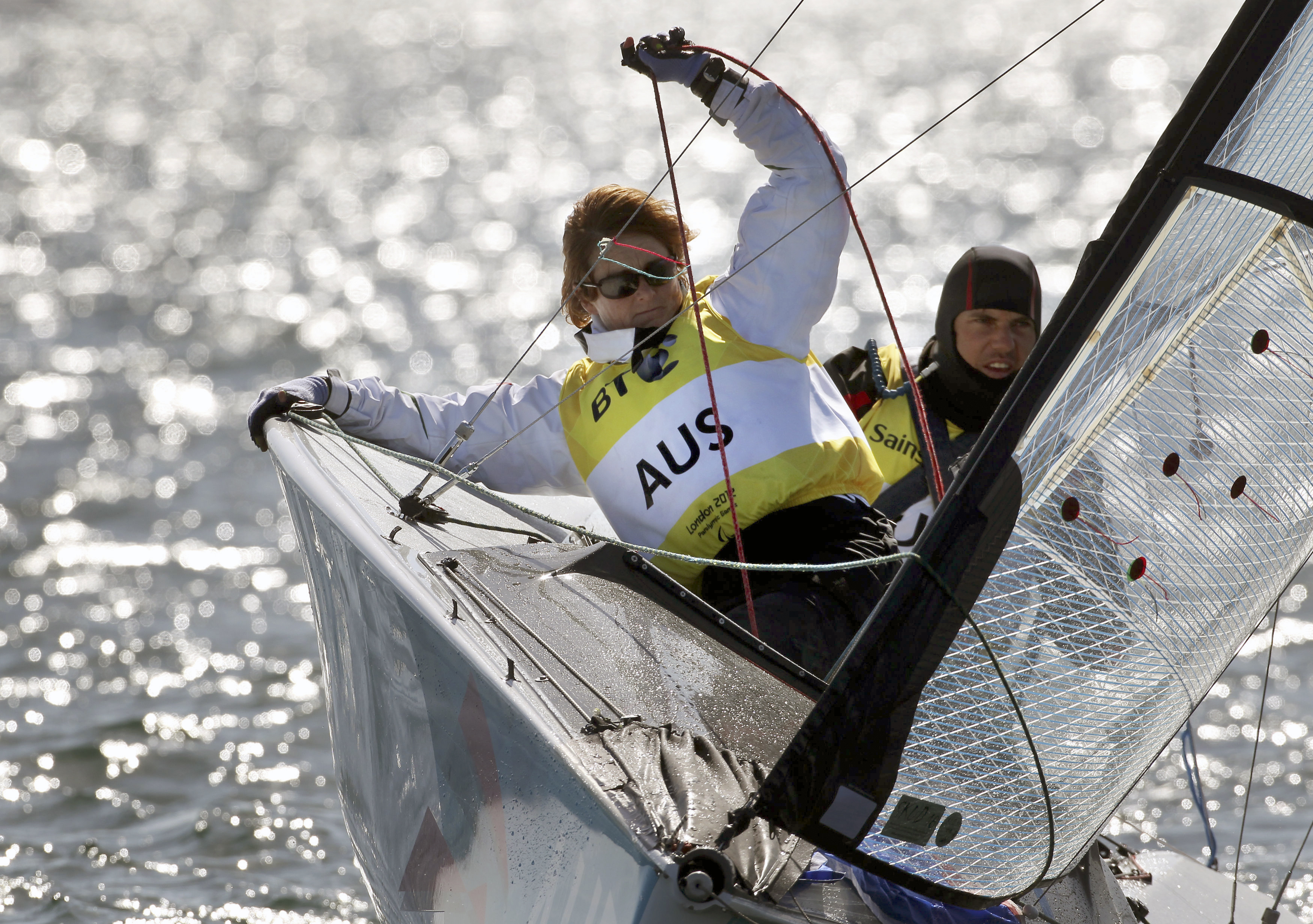 Australian Paralympic sailor and basketball player Liesl Tesch, left, sails with teammate Daniel Fitzgibbon during the 2012 Olympics in Weymouth, England, on Sept. 5, 2012