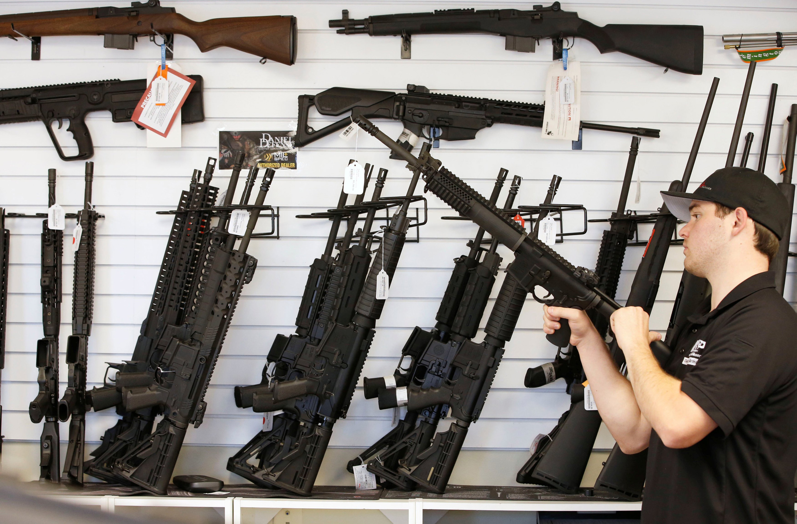A salesman clears the chamber of an AR-15 at the  Ready Gunner  gun store in Provo, Utah on June 21, 2016.