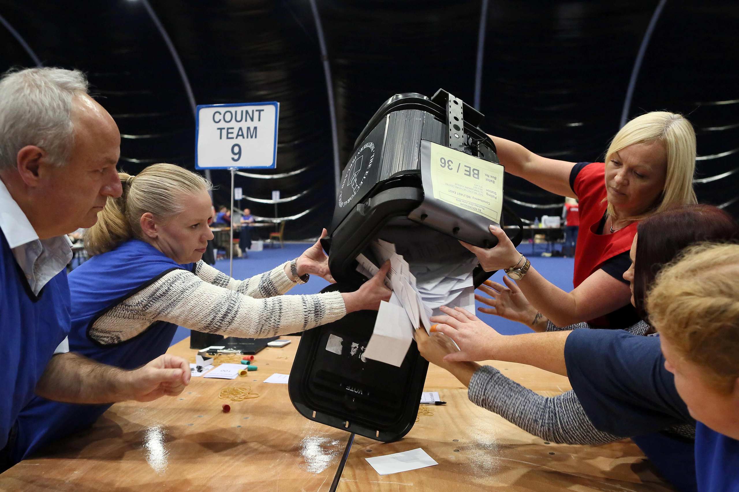 The first ballot boxes are opened at the Titanic Exhibition Center, the Belfast count center after polls closed in the referendum on whether the UK will stay in the European Union on June 23, 2016.