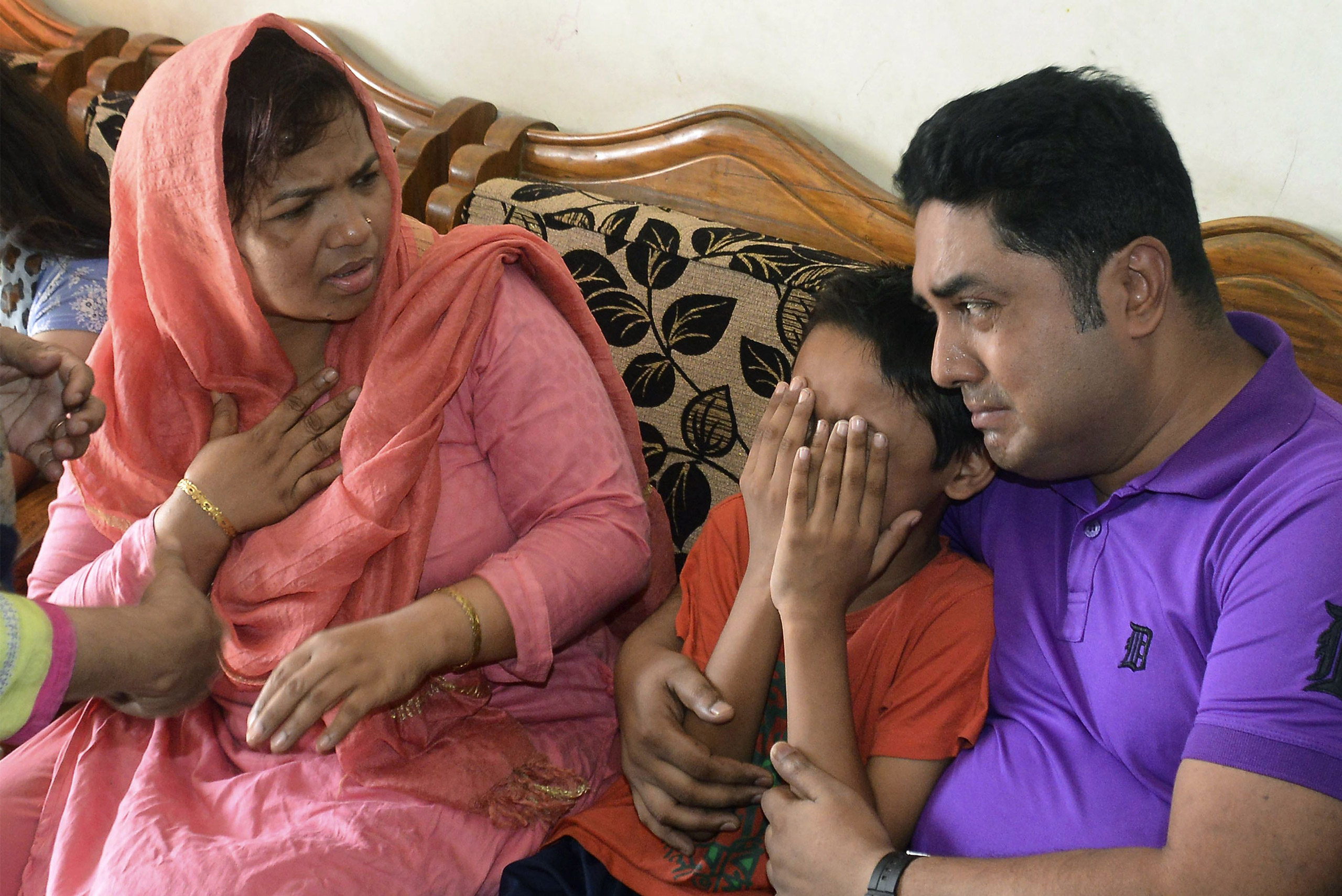 The young son of Mahmuda Aktar, the wife of a top Bangladeshi anti-terror officer,  mourns after she was shot dead near her home in Chittagong on June 5, 2016.
