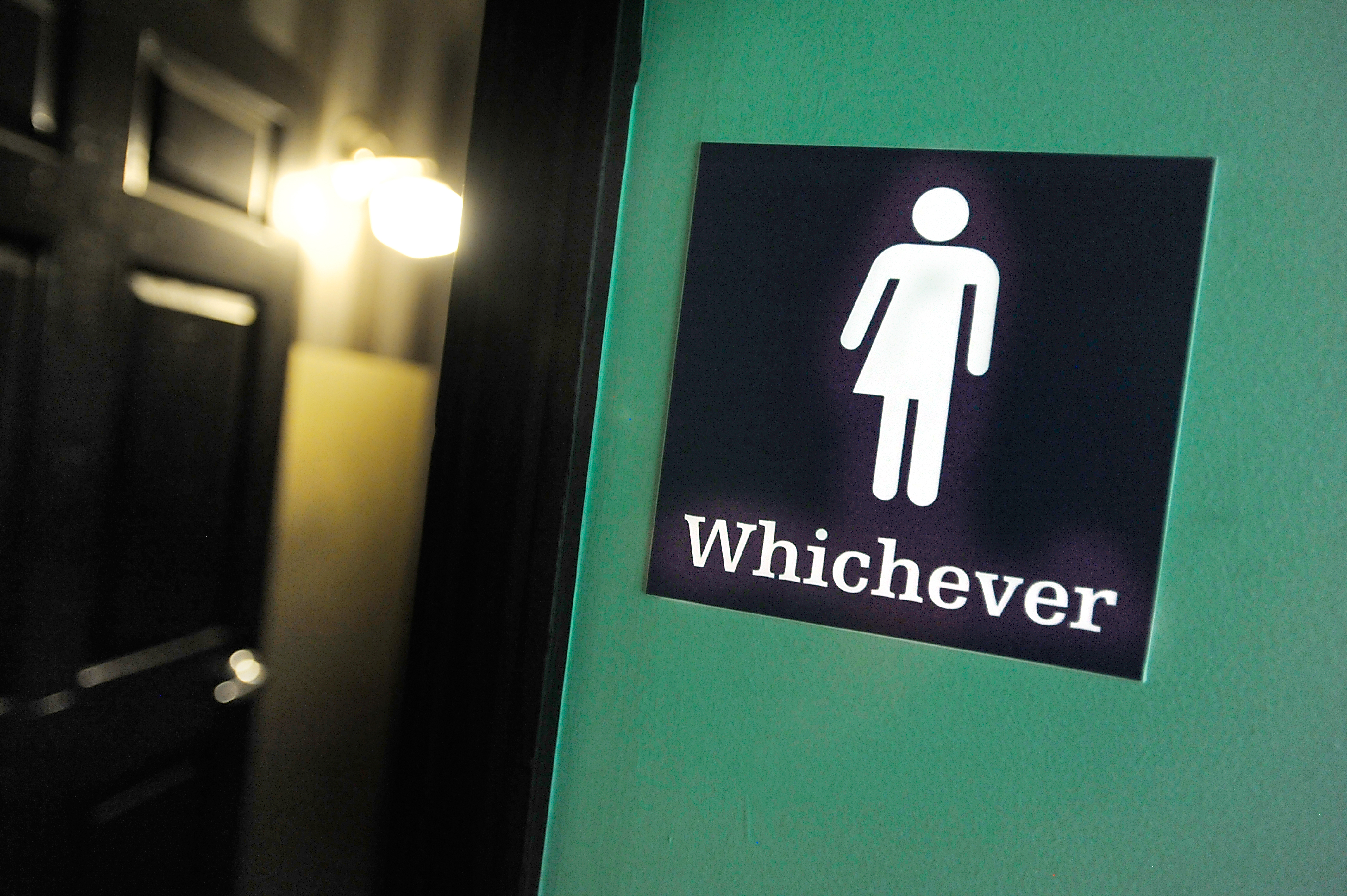 A gender neutral sign is posted outside a bathrooms at Oval Park Grill on May 11, 2016 in Durham, North Carolina.