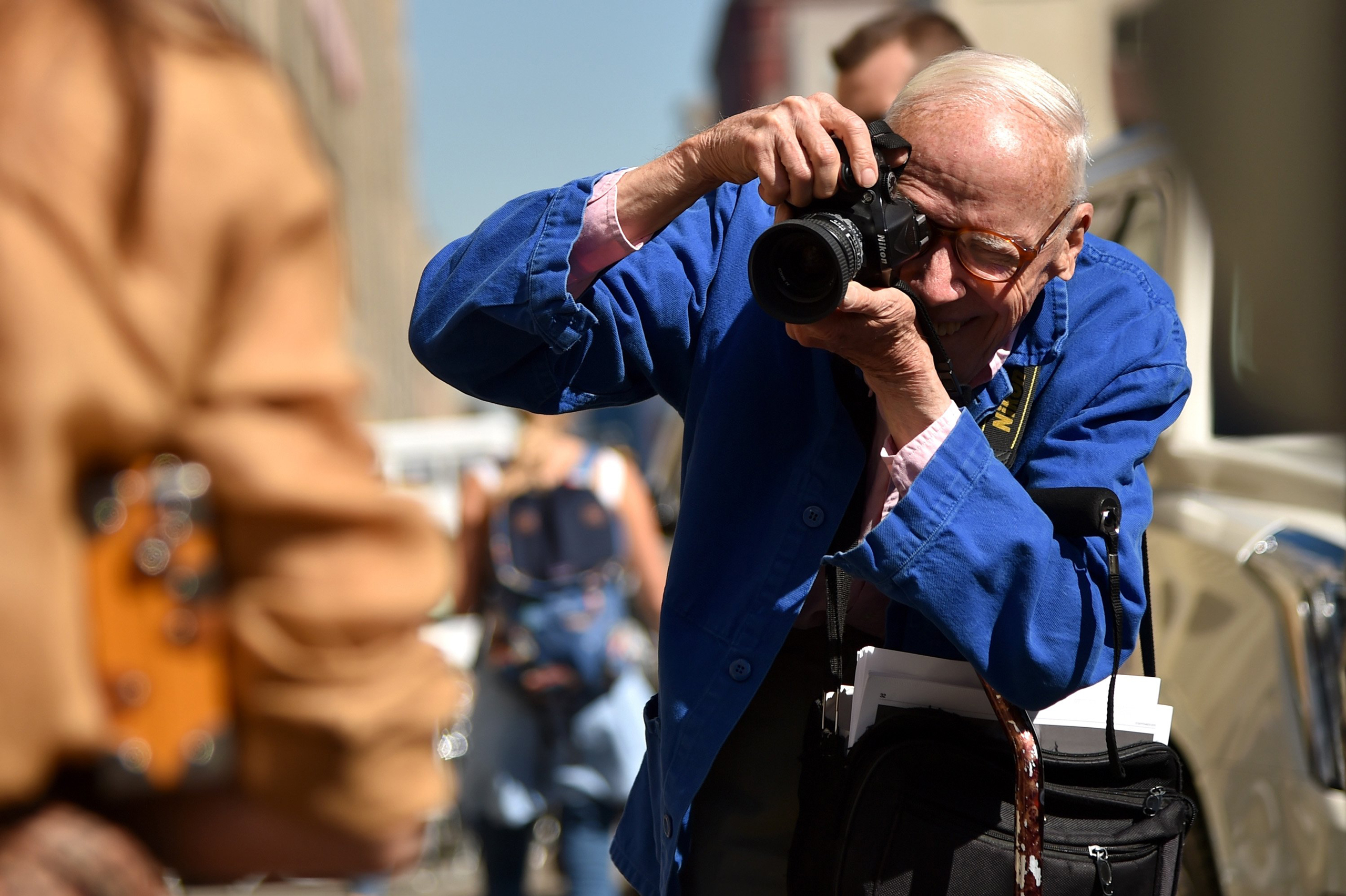 Bill Cunningham photographs guests leaving Ralph Lauren Spring 2016 during New York Fashion Week: The Shows at Skylight Clarkson Sq in New York City on September 17, 2015.