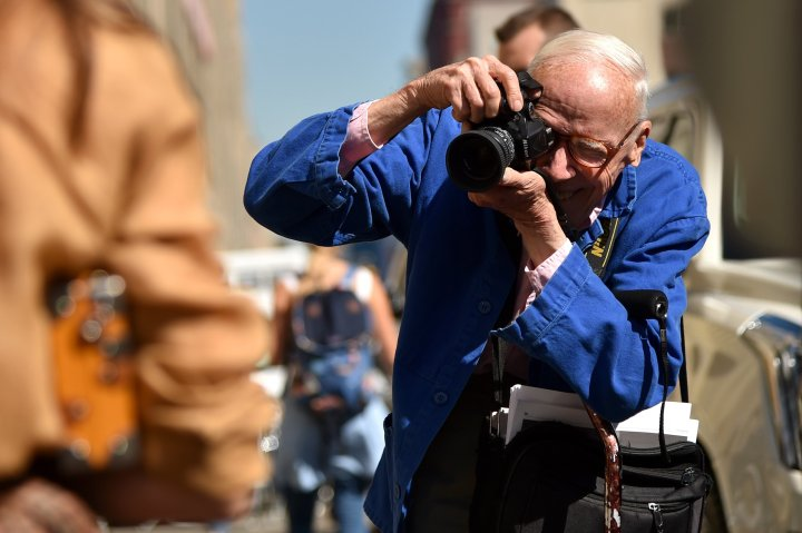 JUNE 25, 2016: It was reported that NY Times fashion photographer Bill Cunningham died at 87, June 25, 2016. He was in the hospital recovering from what appears to have been a stroke. NEW YORK, NY - SEPTEMBER 17: Bill Cunningham photographs guests leaving Ralph Lauren Spring 2016 during New York Fashion Week: The Shows at Skylight Clarkson Sq on September 17, 2015 in New York City. (Photo by Mike Coppola/Getty Images for NYFW: The Shows)