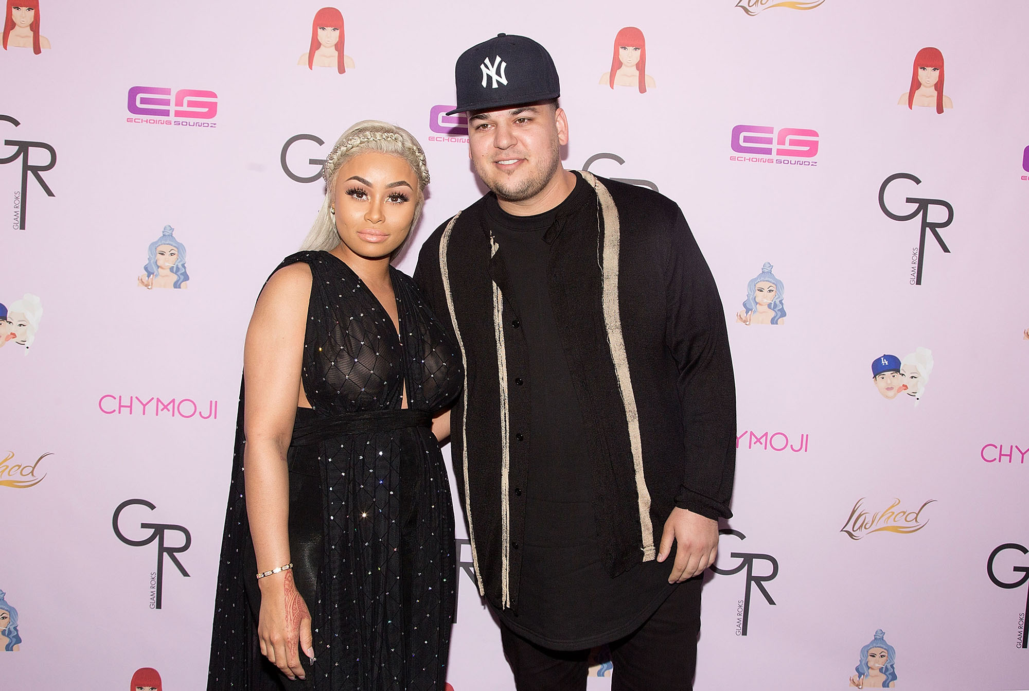 HOLLYWOOD, CA - MAY 10:  Blac Chyna (L) and Rob Kardashian arrive for her Blac Chyna's birthday celebration and unveiling of her  Chymoji  Emoji Collection at Hard Rock Cafe, Hollywood, CA  (Photo by Gabriel Olsen/WireImage)
