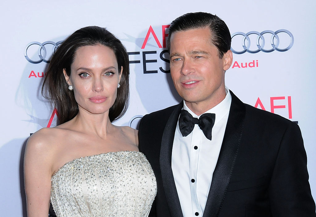 HOLLYWOOD, CA - NOVEMBER 05:  (L-R) Director/producer/writer/actress Angelina Jolie and actor Brad Pitt arrive at AFI FEST 2015 Presented By Audi Opening Night Gala Premiere Of Universal Pictures' 'By The Sea' at TCL Chinese 6 Theatres on November 5, 2015 in Hollywood, California.  (Photo by Barry King/Getty Images)