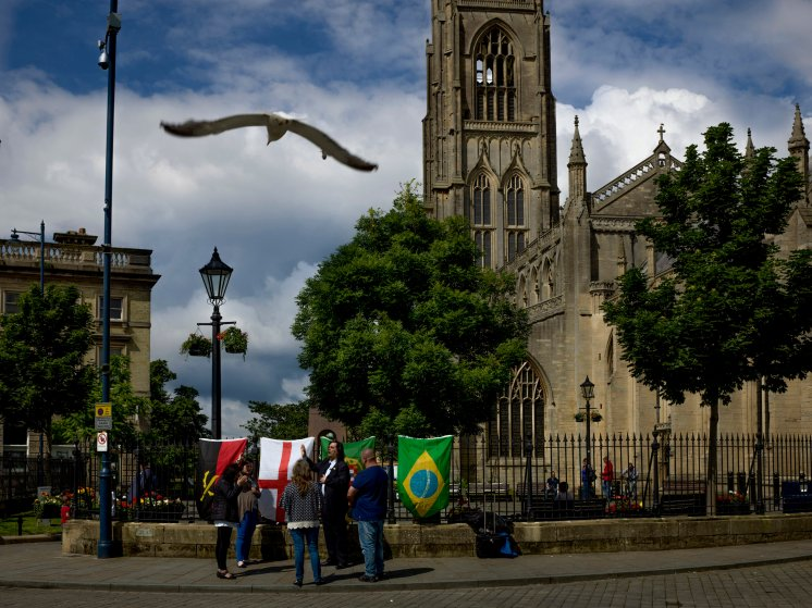 Members of a newly organized church group from Portugal and Brazil stand in Boston's main square singing prayers. Boston, Lincolnshire, June 26, 2016.