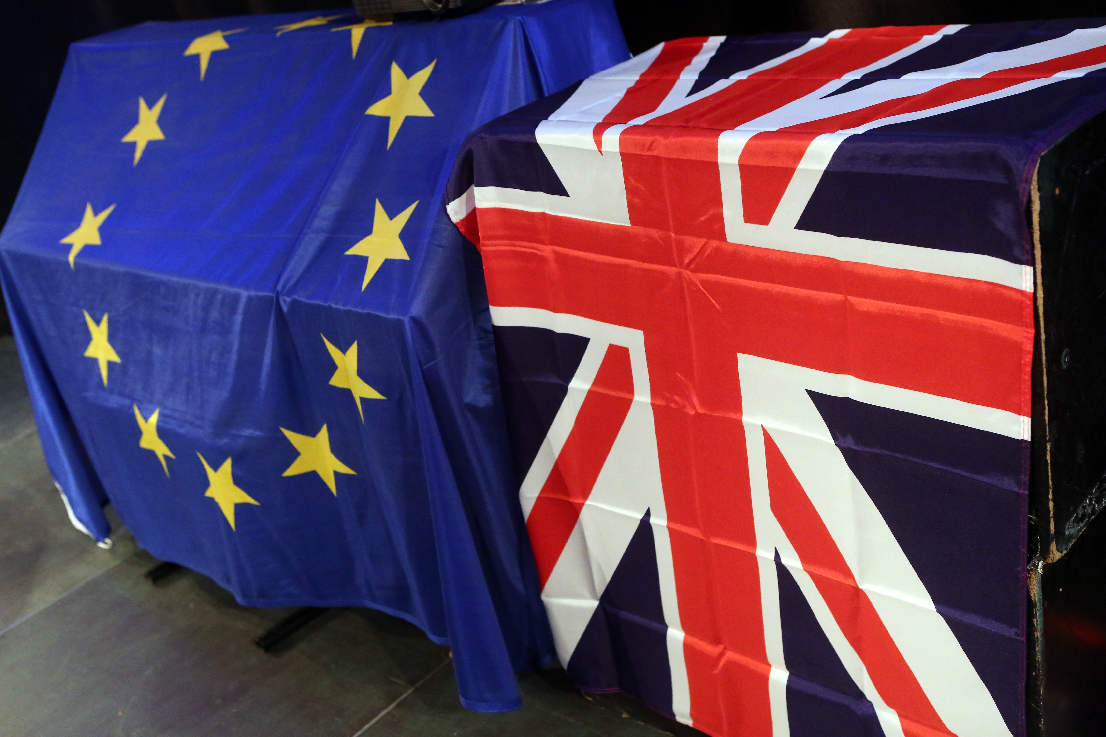 European Union and British Union Jack flags hang at a meeting for British citizens living in Germany to discuss the implications of Great Britain leaving the European Union, known popularly as Brexit, on May 26, 2016 in Berlin, Germany.