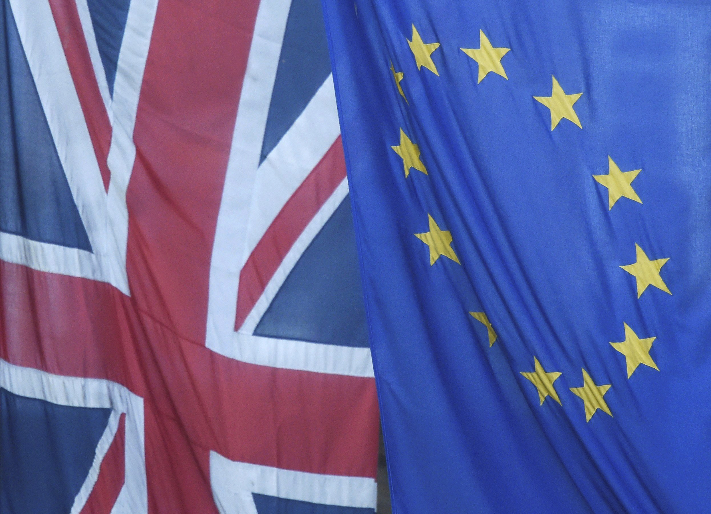 A Union Jack flag flies next to the flag of the European Union in Westminster, London, on June 24, 2016.