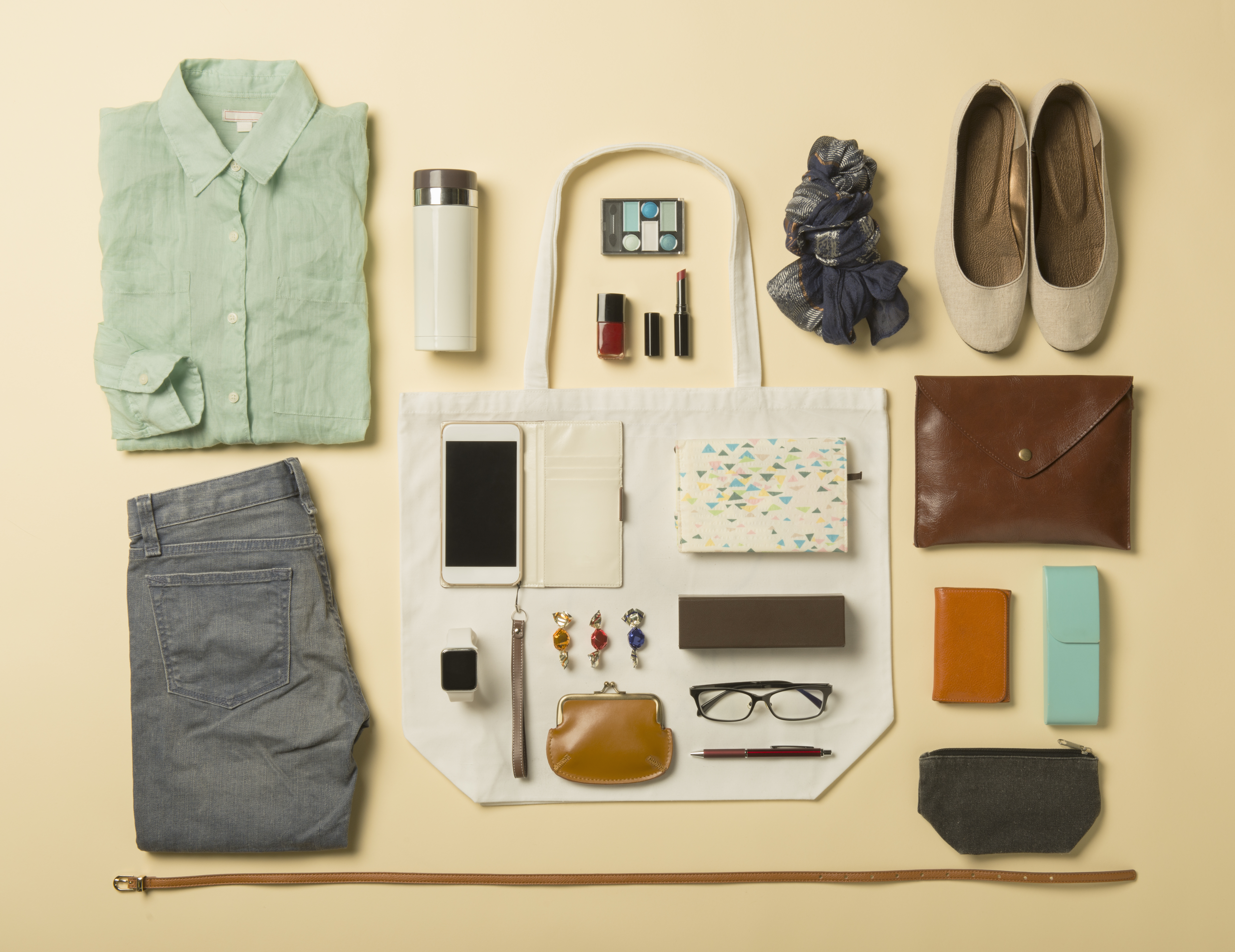 Woman daily supplies shot knolling style.