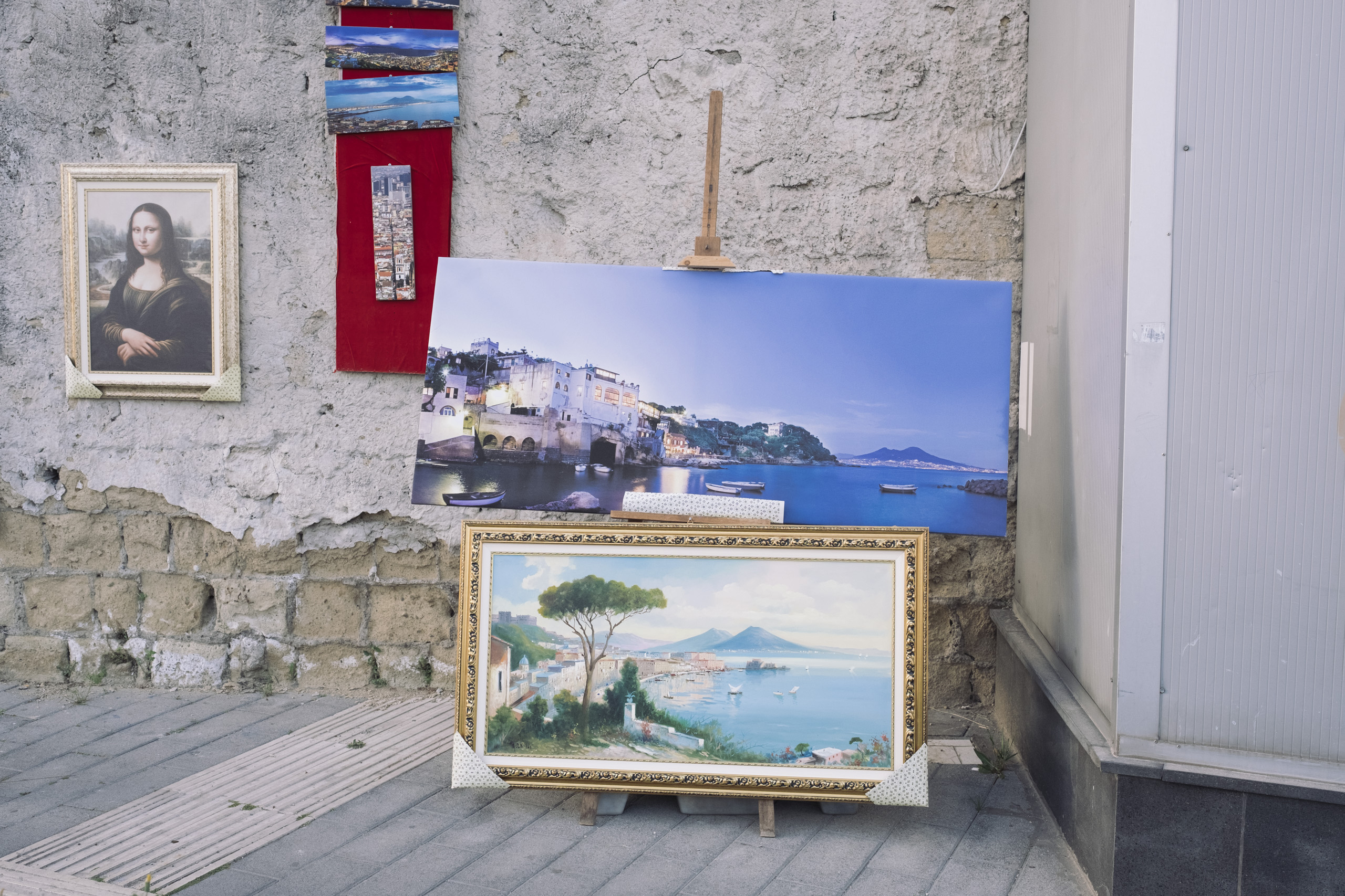 Prints of the most iconic views of Naples are sold on Via Marina, the main arterial road to enter into the city, April, 2016.