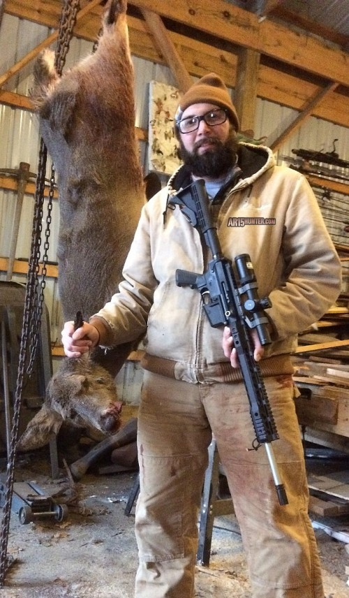 Will Chambers, right, with a deer he killed with his AR-15 rifle.