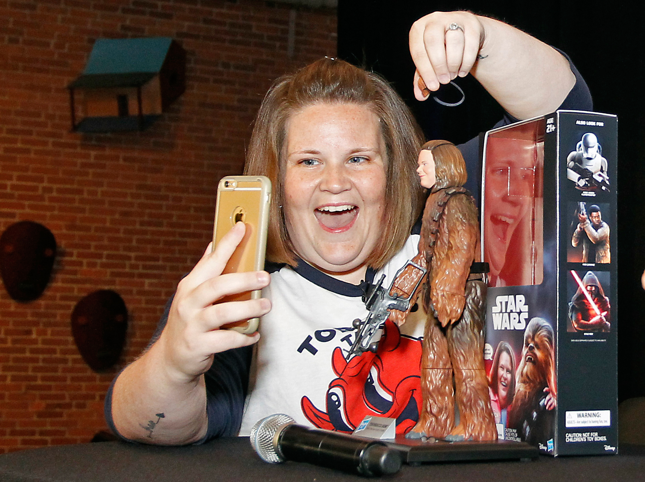 Candace Payne, also known as Chewbacca Mom, streams a Facebook Live video with her custom Chewbacca Mom action figure during a meet and greet at Hasbro HQ in Pawtucket, R.I., on June 17, 2016.