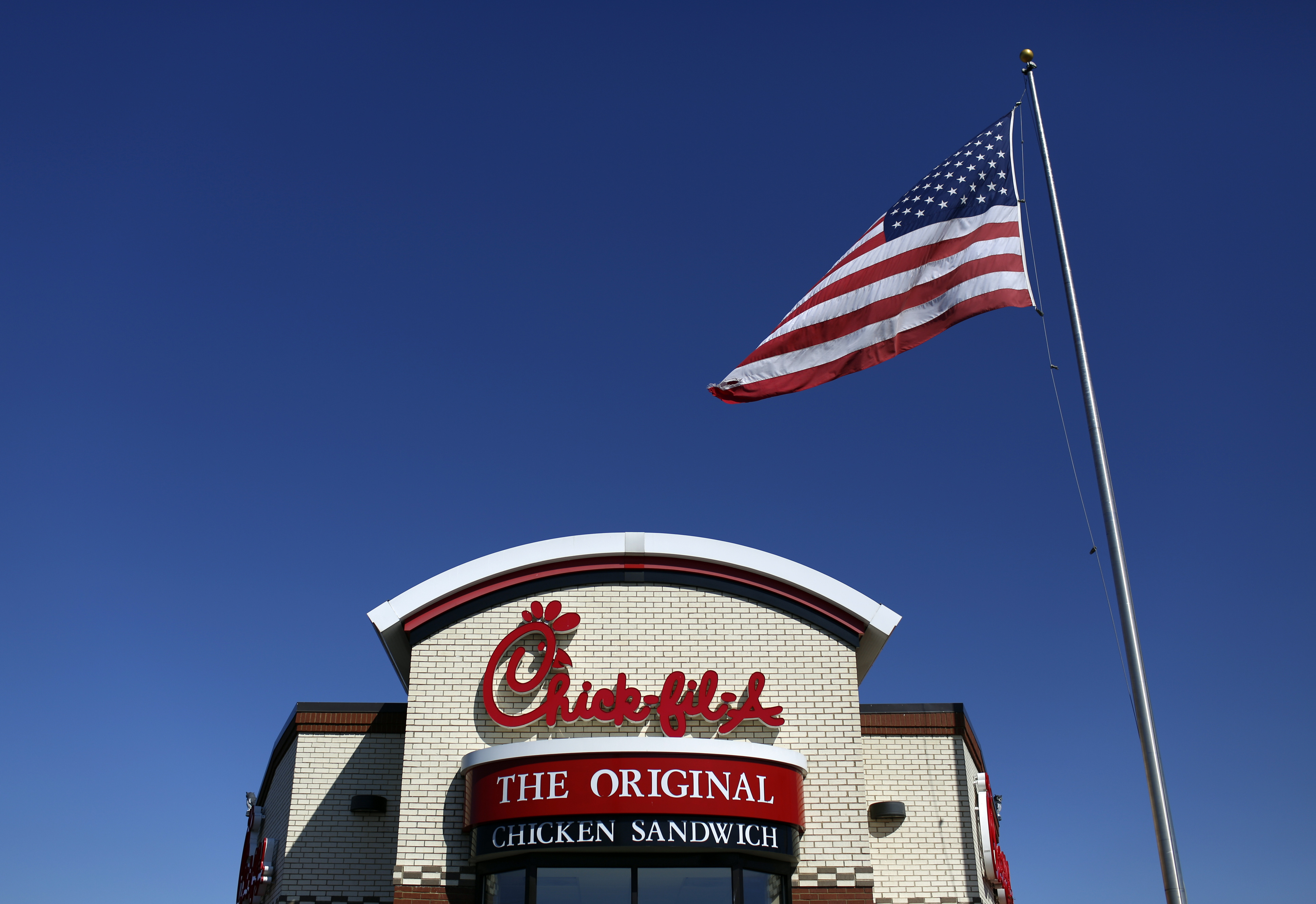 A U.S. flag flies outside a Chick-fil-A Inc. restaurant in Bowling Green, Kentucky in Mach 2014.