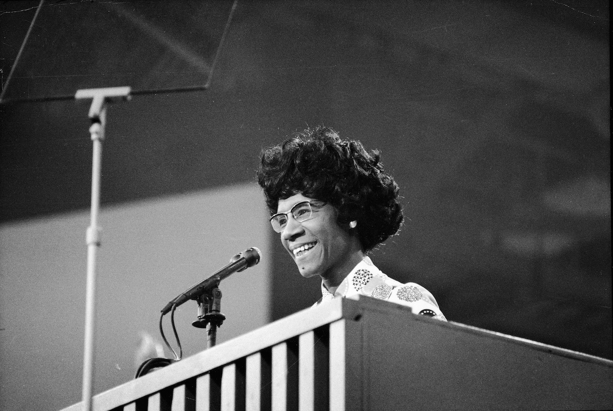 Congresswoman Shirley Chisholm speaks at a podium at the Democratic National Convention, Miami Beach, Florida, July 1972.