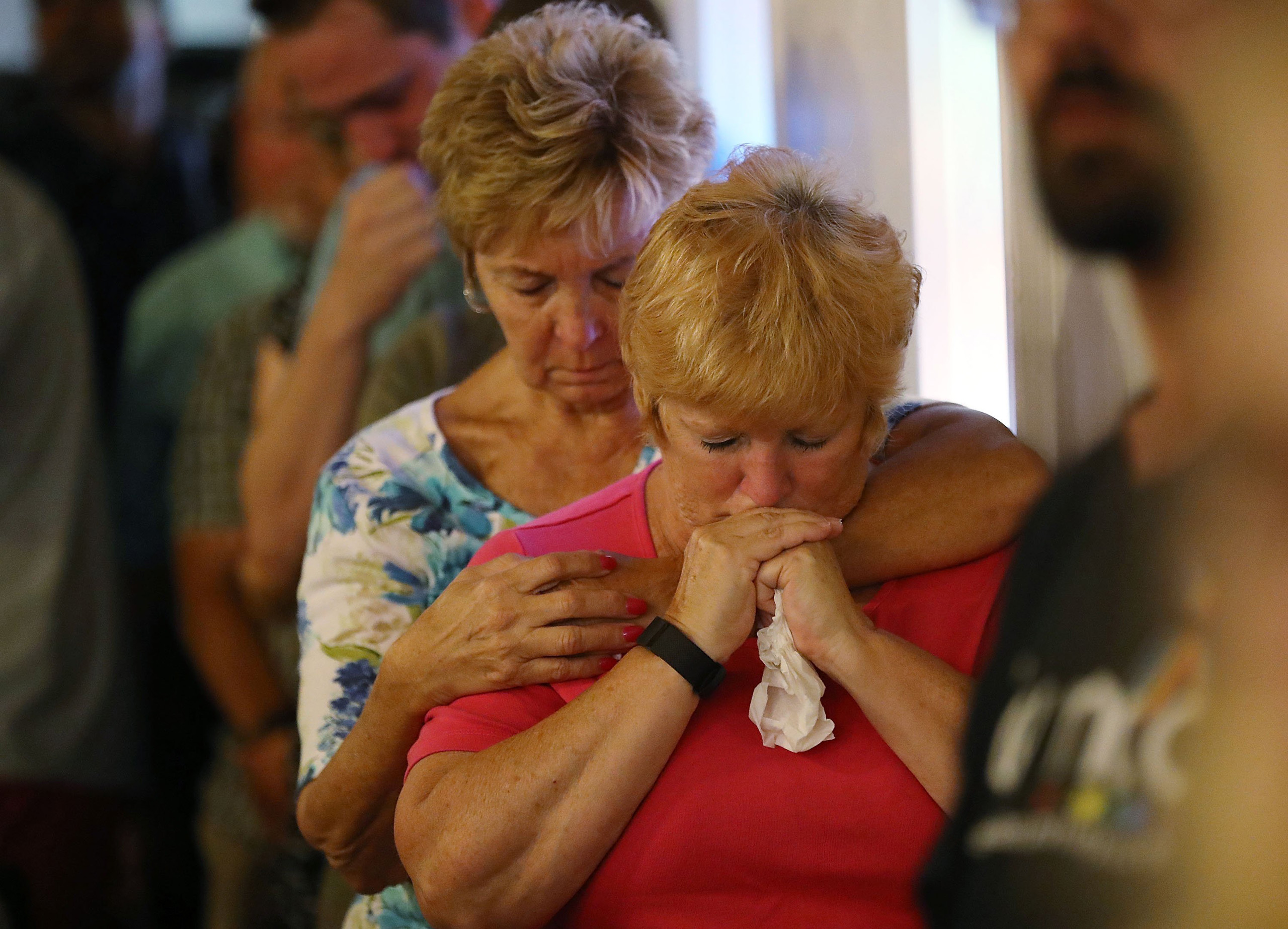Mourners attend a memorial service at the Joy MCC Church for the victims of the terror attack at the the Pulse Nightclub where Omar Mateen allegedly killed more than 50 people in Orlando on June 12, 2016.