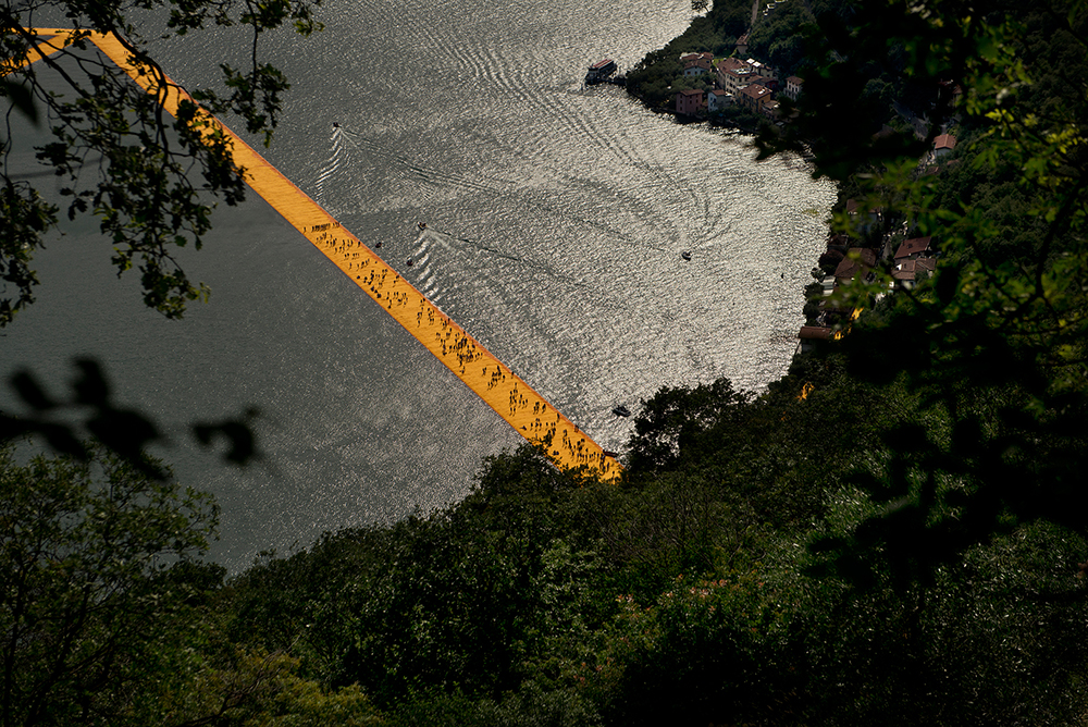 People walk on part of the Christo art installation,  The Floating Piers,  on Lake Iseo, Italy, June 2016.