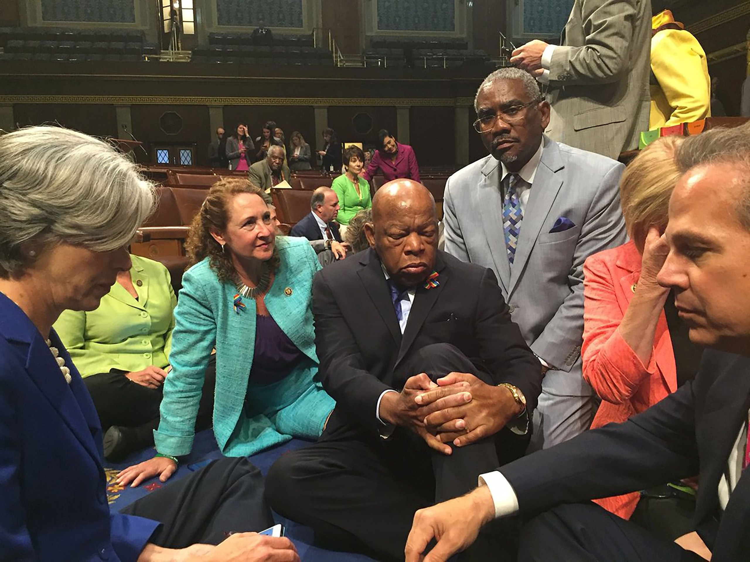 Rep. Esty(2n-L) with Rep. John Lewis(C) and other members of Congress staging a sit-in on the floor of the US House of Representatives in Washington, D.C. on June 22, 2016.
