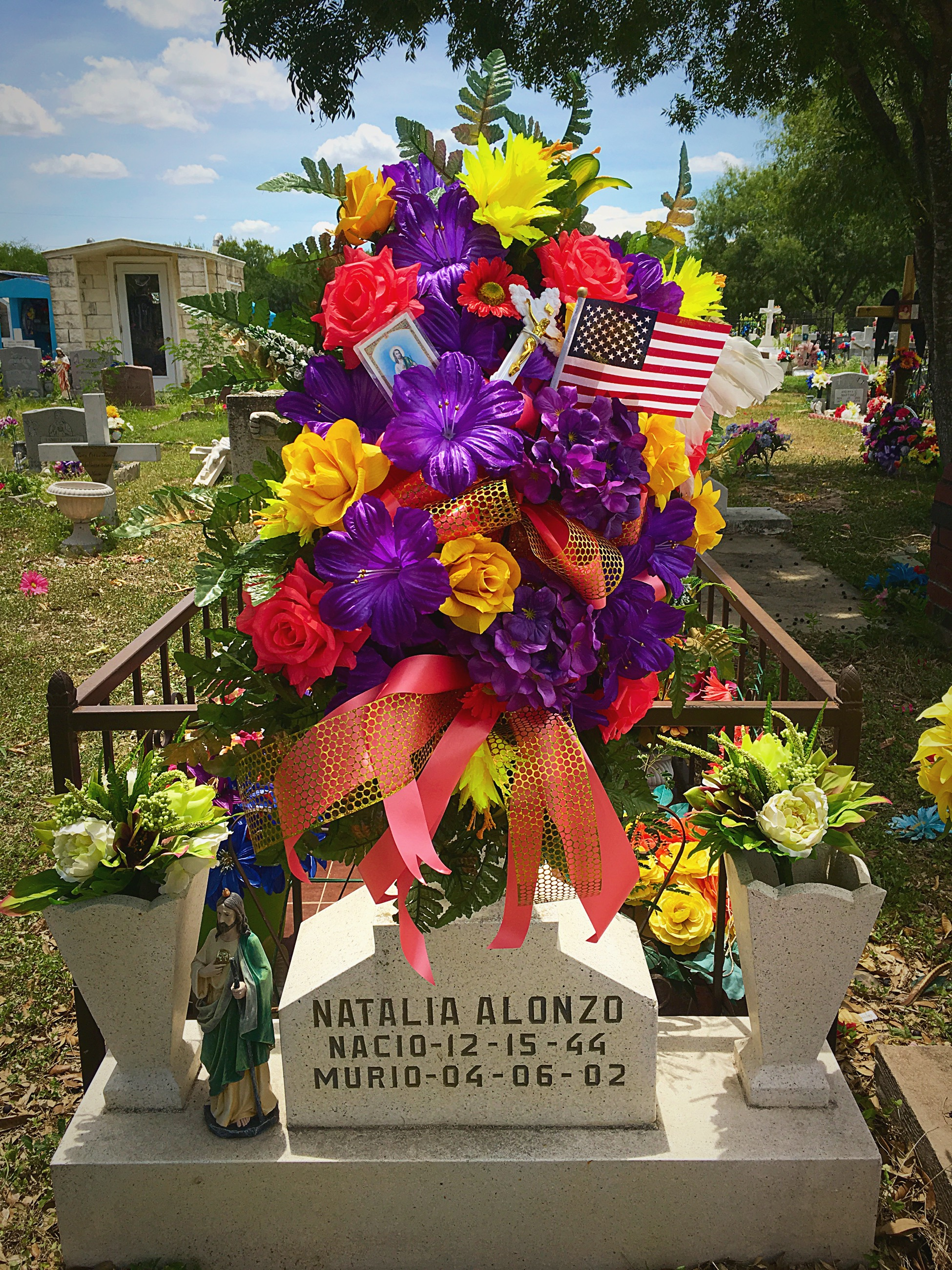 The grave of Natalia Alonzo, which features a new American flag.