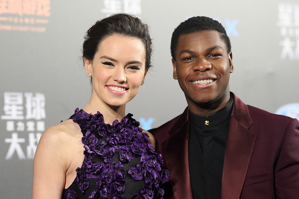 Actress Daisy Ridley and actor John Boyega attend 'Star Wars: The Force Awakens' premiere at Shanghai Grand Theatre on December 27, 2015 in Shanghai, China.