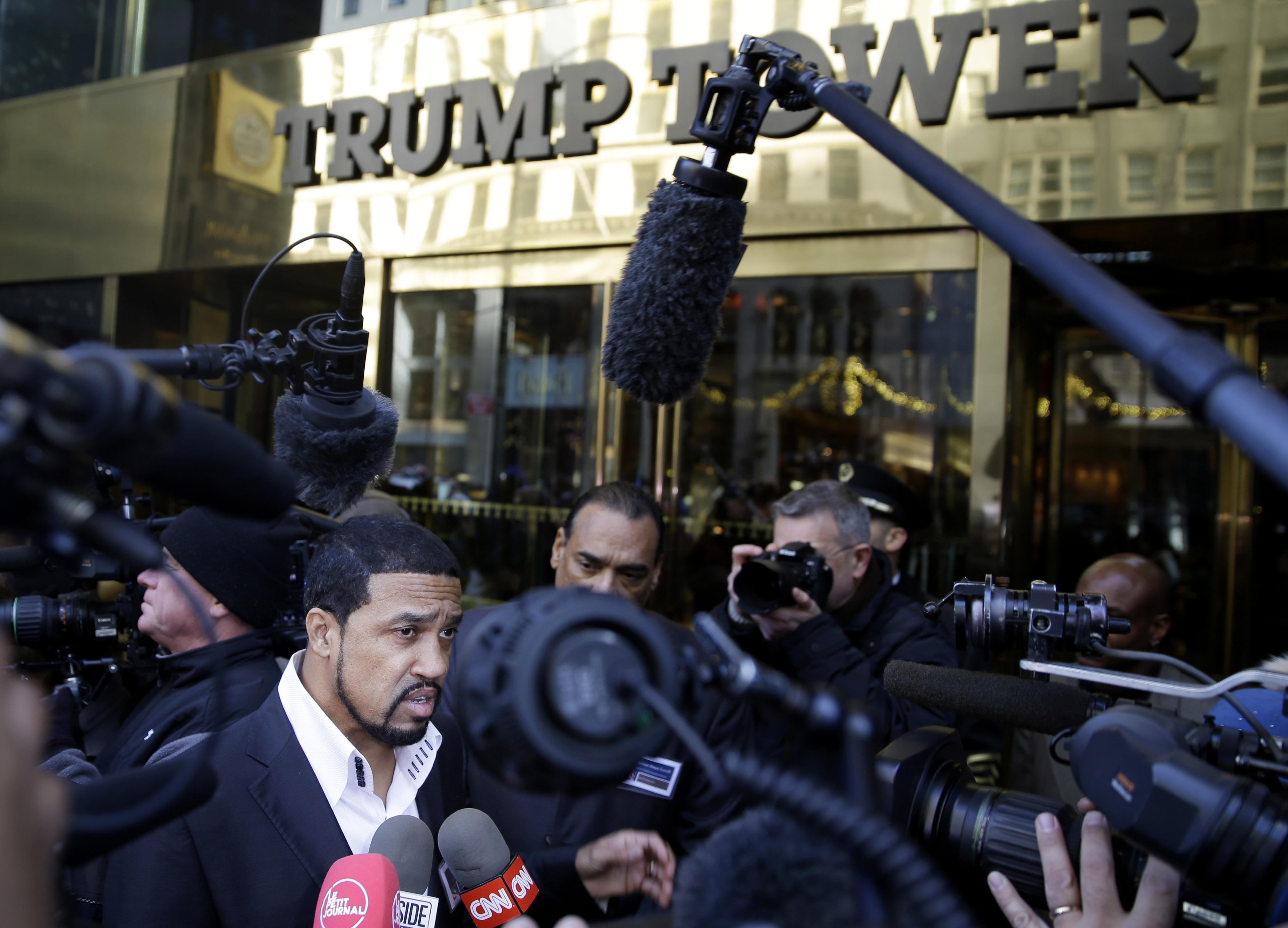 Pastor Darrell Scott, bottom left, of the New Spirit Revival Center in Ohio, speaks to reporters outside of Trump Tower in New York.