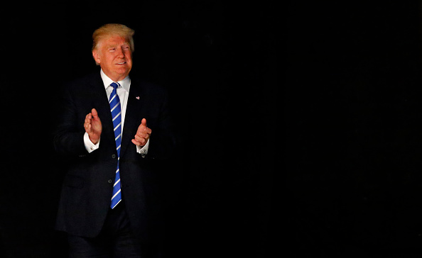 Republican presidential candidate Donald Trump arrives on stage June 16, 2016 at Gilley's in Dallas, Texas. Trump arrived in Texas on Thursday with plans to hold rallies and fundraisers. (Photo by Ron Jenkins/Getty Images)