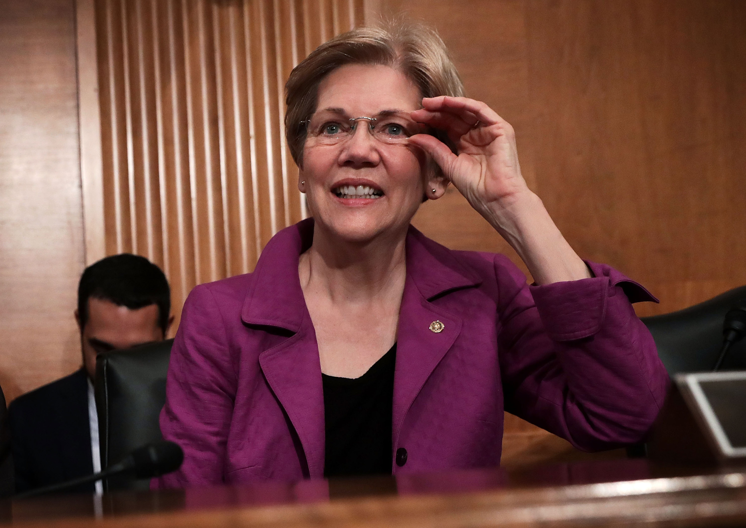Sen. Elizabeth Warren waits for the beginning of a hearing before the Senate Banking, Housing and Urban Affairs Committee in Washington, D.C., April 7, 2016.
