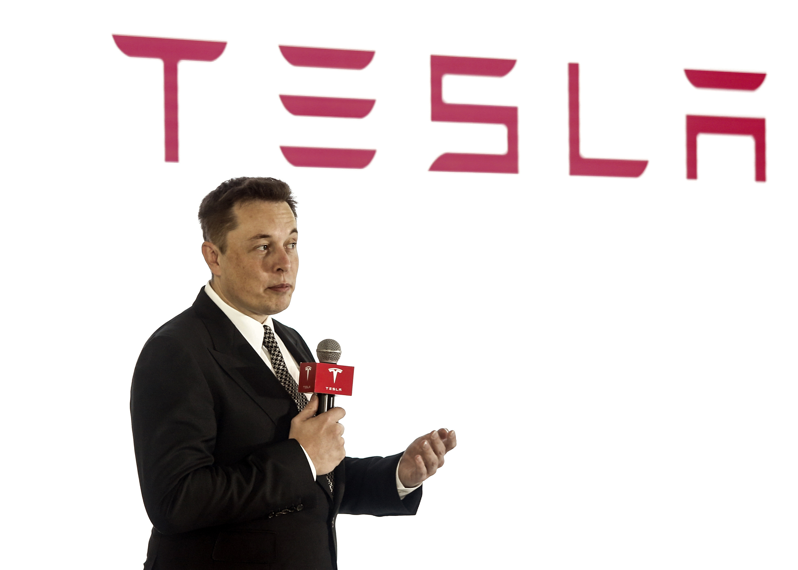 Elon Musk addresses a press conference to declare that the Tesla Motors releases v7.0 System in China on October 23, 2015. in Beijing, China.