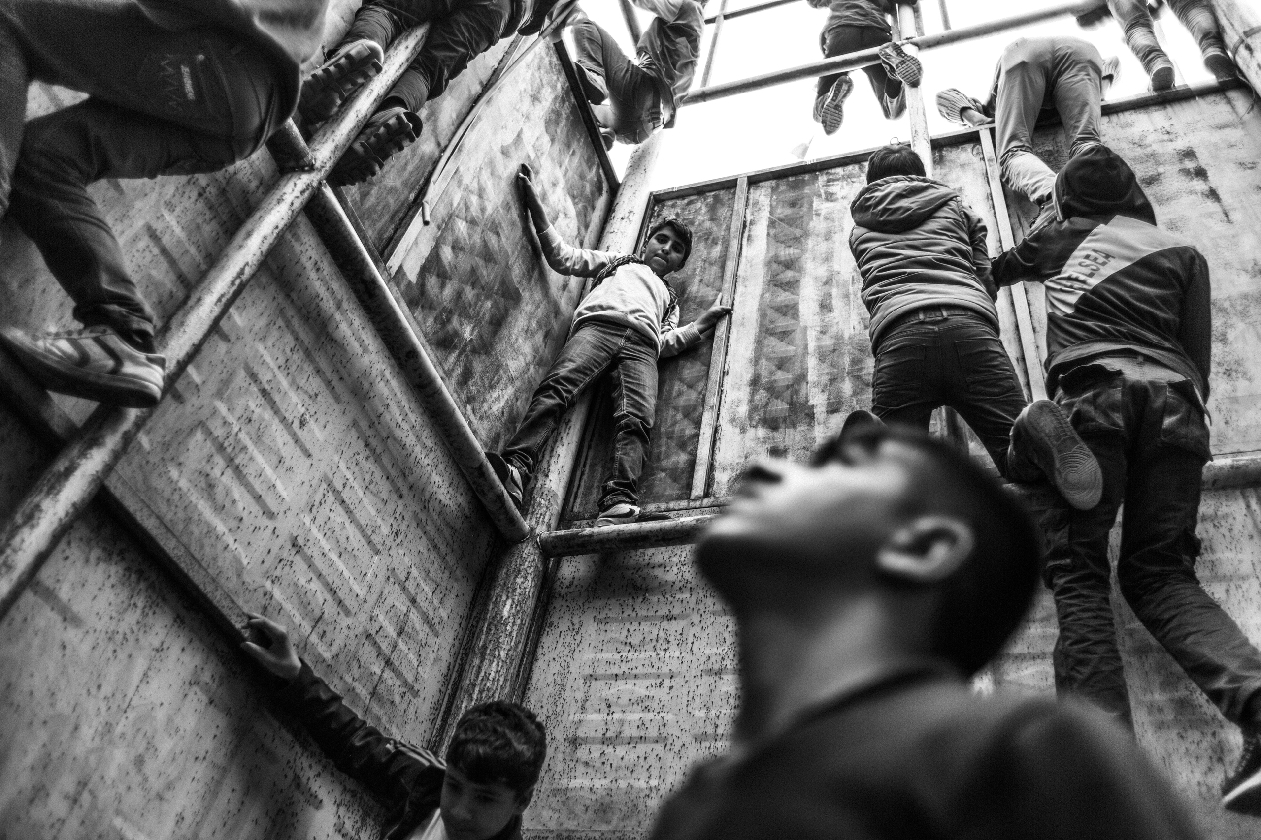 Young boys climb a platform adorned with flags during Newroz celebrations in Diyarbakir, Turkey, March 2016. In southeastern Turkey, clashes between Turkish military security forces and the Kurdish separatists resumed in the summer of 2015 after a two-year cease fire.