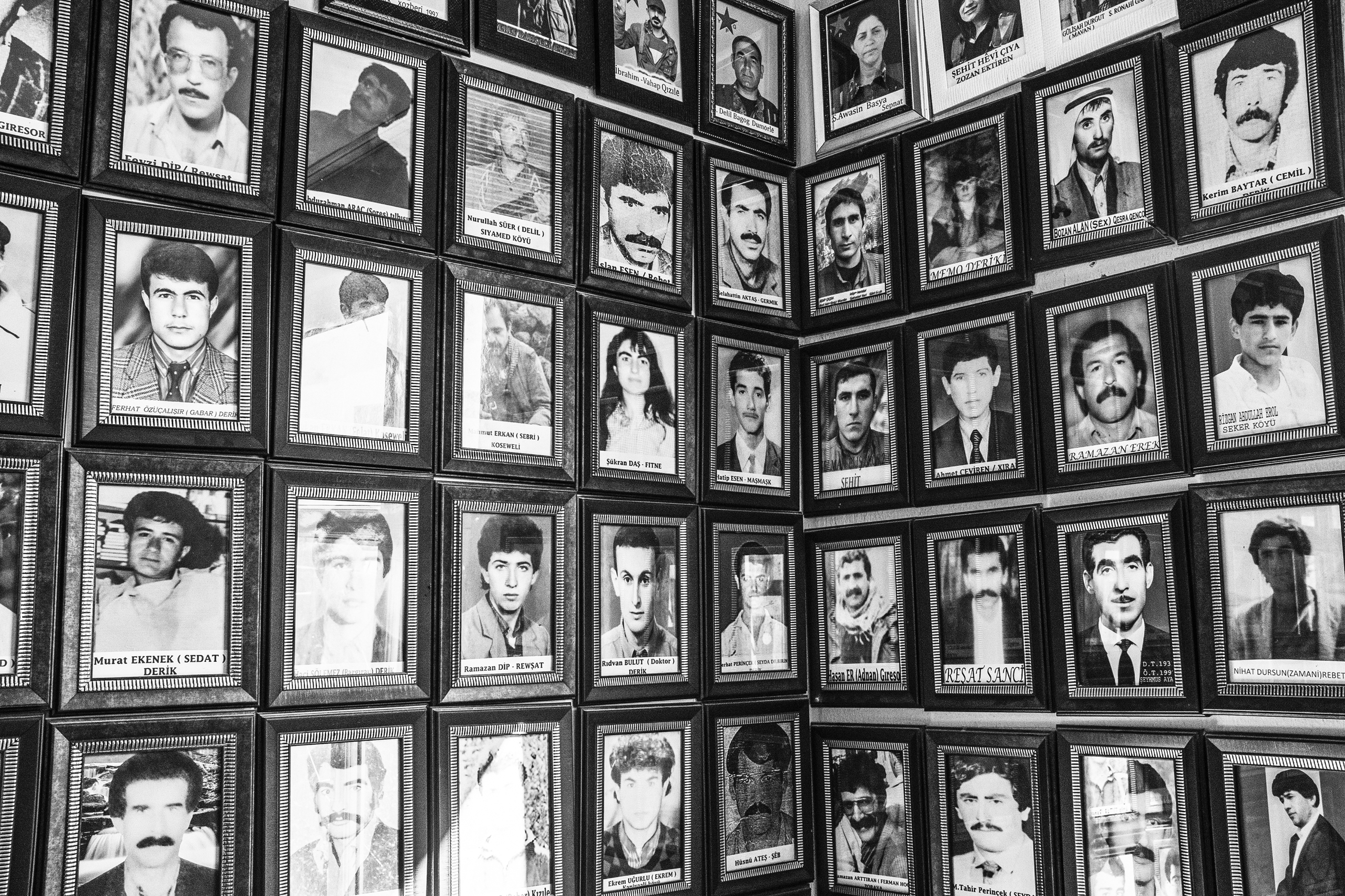 Portraits of Derik's Kurdistan Workers Party (PKK) members  who have been killed by Turkish security forces over the last 40 years hang on a wall, Derik, Turkey, Dec. 2015.
