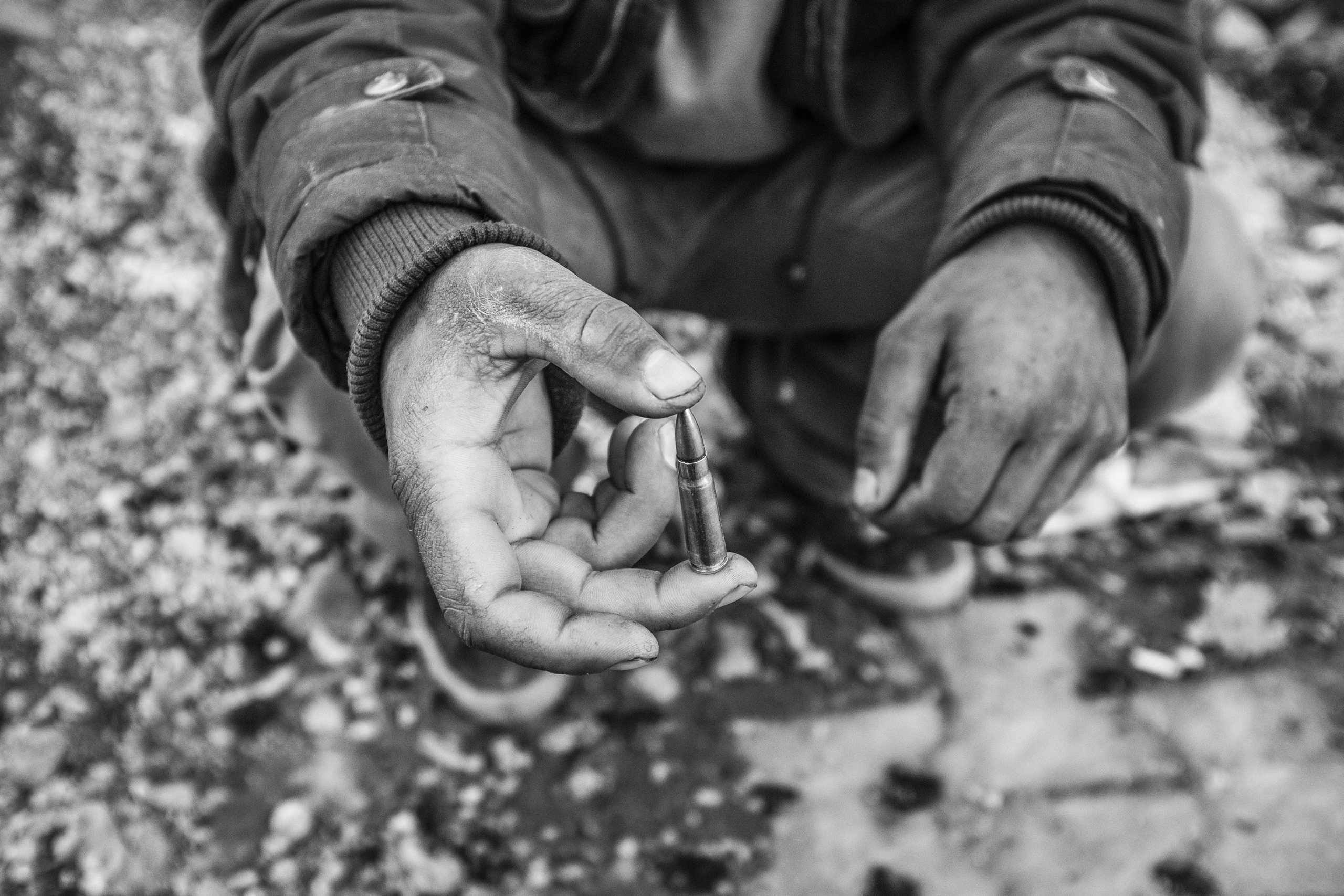 A member of Revolutionary Patriot Youth Movement (YDG-H) shows a bullet used during clashes against Turkish special military forces, Nusaybin, Turkey, Dec. 2015.