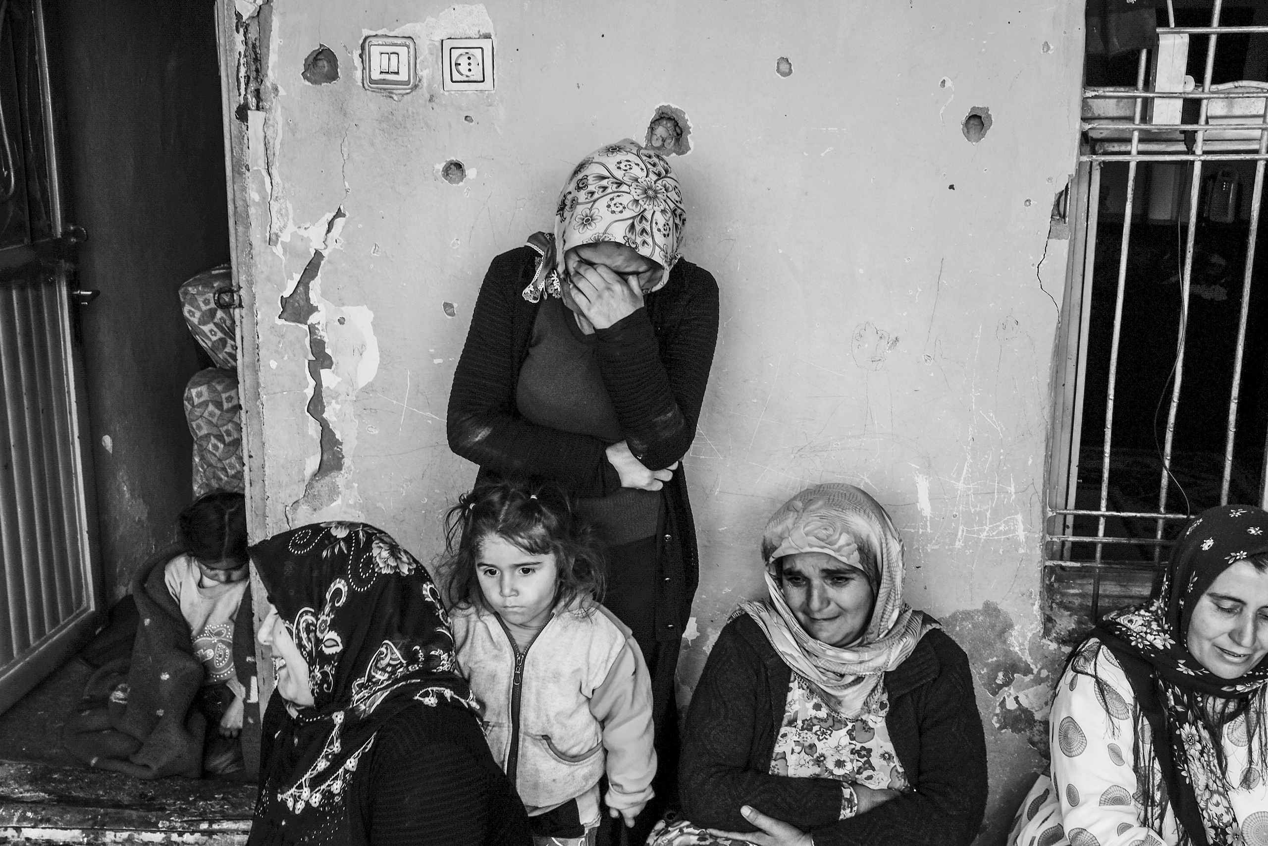 A family mourns the death of their 17-year-old son, Kasim,  who was killed when the building he was in was destroyed by Turkish special forces, Cizre, Turkey, March 2016.