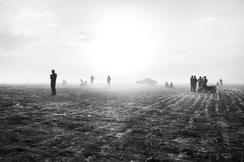Kurdish Syrian refugees from kobani, Syria wait near the Turkish-Syrian border, Sept. 2014, as the Islamic State of Iraq (ISIS) began an attack on the city, eventually overtaking it in Oct. 2014. Children and elderly crossed mine fields separating Kobani from the Turkish border, in an effort to flee the fighting. According to UNHCR, 170,000 inhabitants of Kobani took refuge in the camps in Turkey.