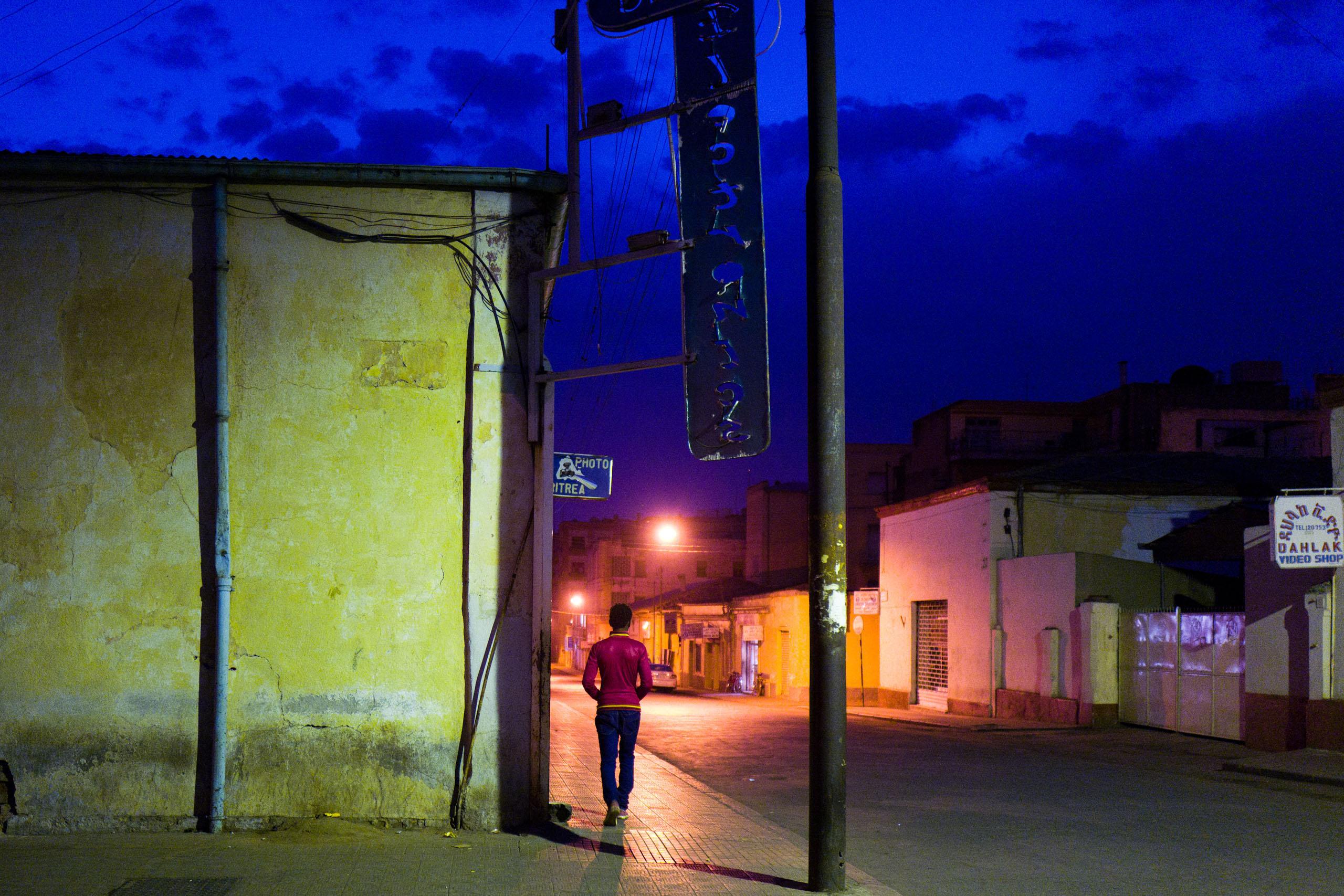 On the street at night in Asmara.