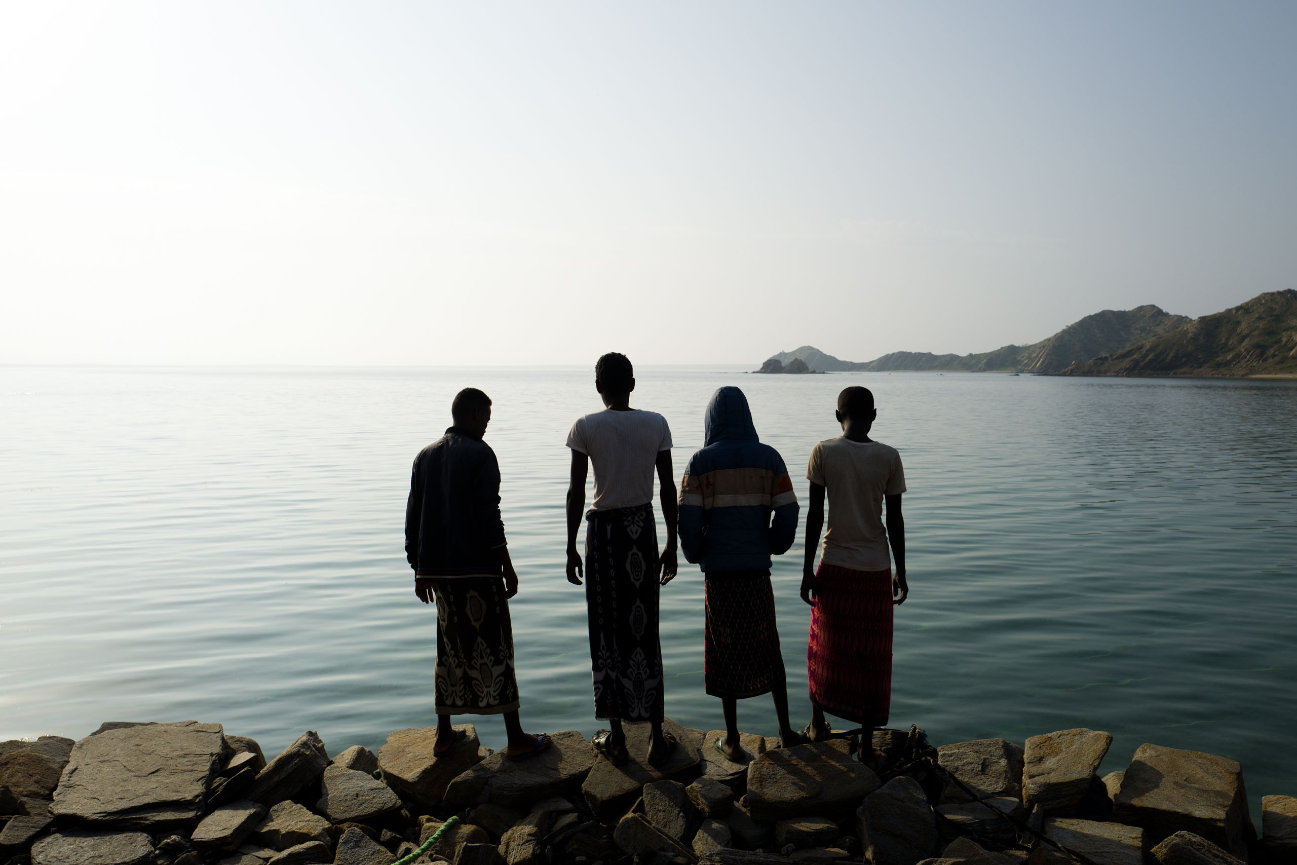 Fishermen looking  out to sea, Dissie Island, Dahlak Archipelago.