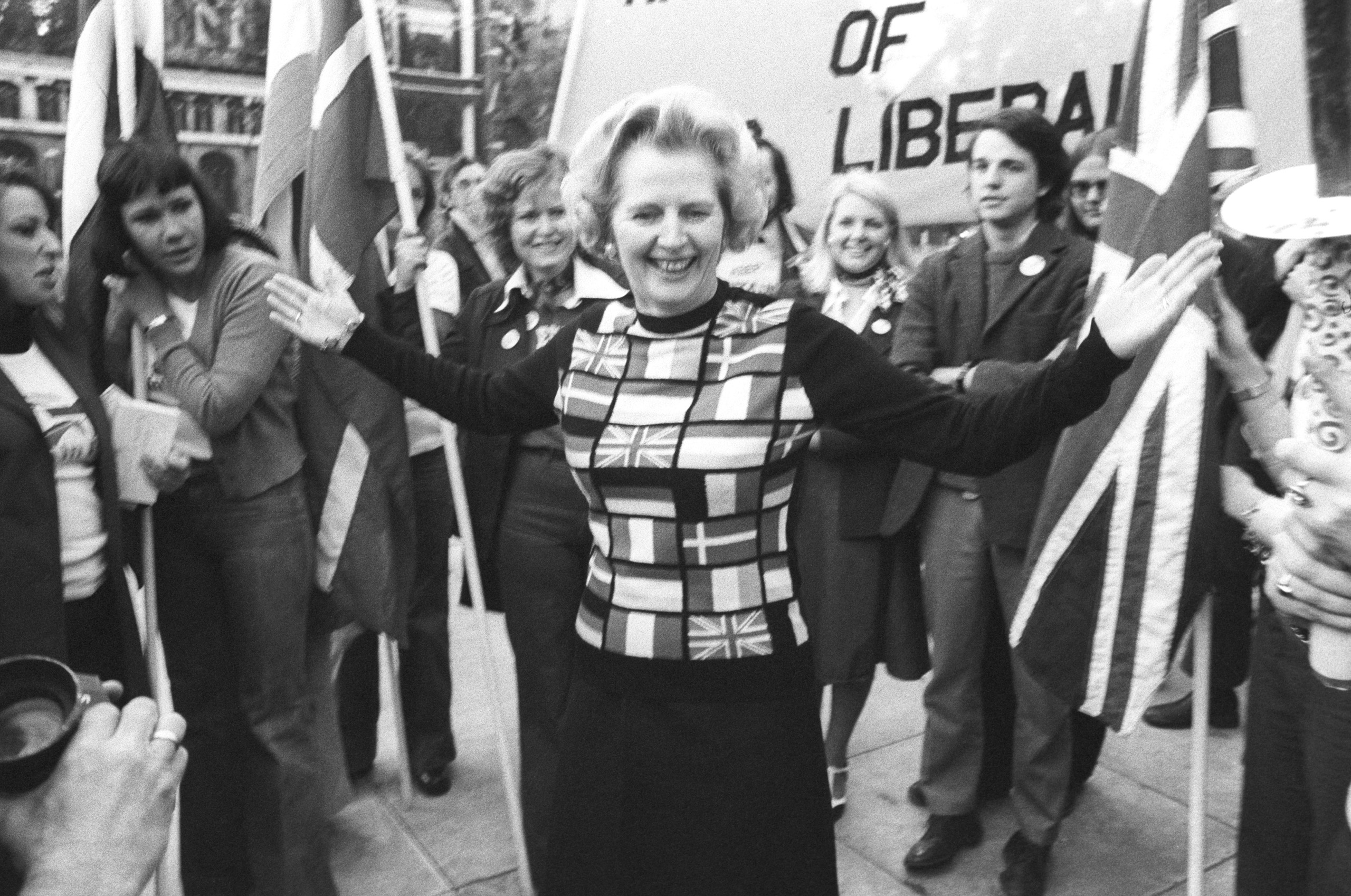 Margaret Thatcher, sporting a sweater bearing the flags of European nations, in Parliament Square during her 'Yes to Europe' campaign, 1975.